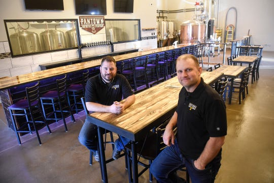 Pantown Brewing Company owners Noel Johnson and Marty Czech are pictured Thursday, Dec. 6, in the main customer area of the new St. Cloud Business.