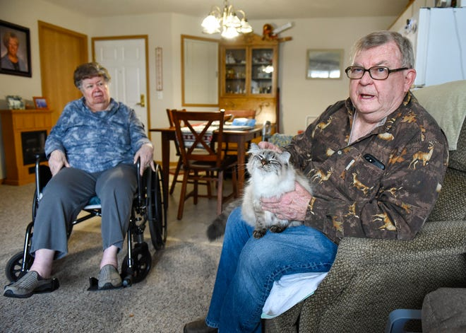Barb and Harold Nelson talk about the fun they have with their cat, Lena, Wednesday, Dec. 5, at Ridgeview Place Senior Living in Sauk Rapids.
