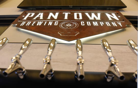 The Pantown Brewing Company logo is installed above taps at the St. Cloud business.