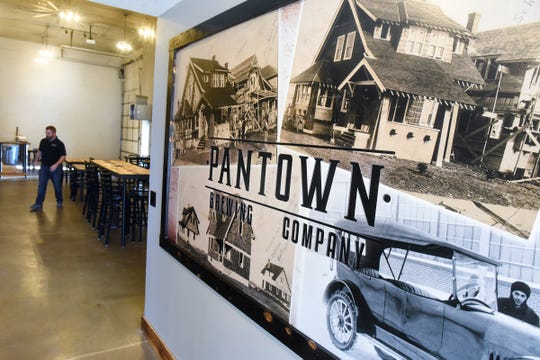 Historic photos from the early years of Pantown are displayed near the entrance to Pantown Brewing Company.
