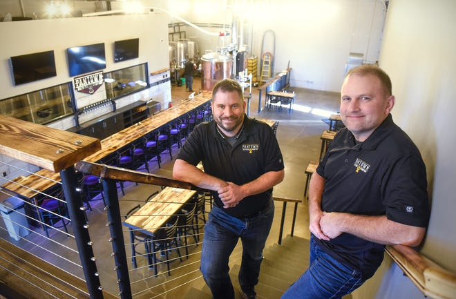 Pantown Brewing Company owners Noel Johnson and Marty Czech stand on the stairs leading to a loft seating area in the new brewery Thursday, Dec. 6, in St. Cloud. The business is expected to open this month.