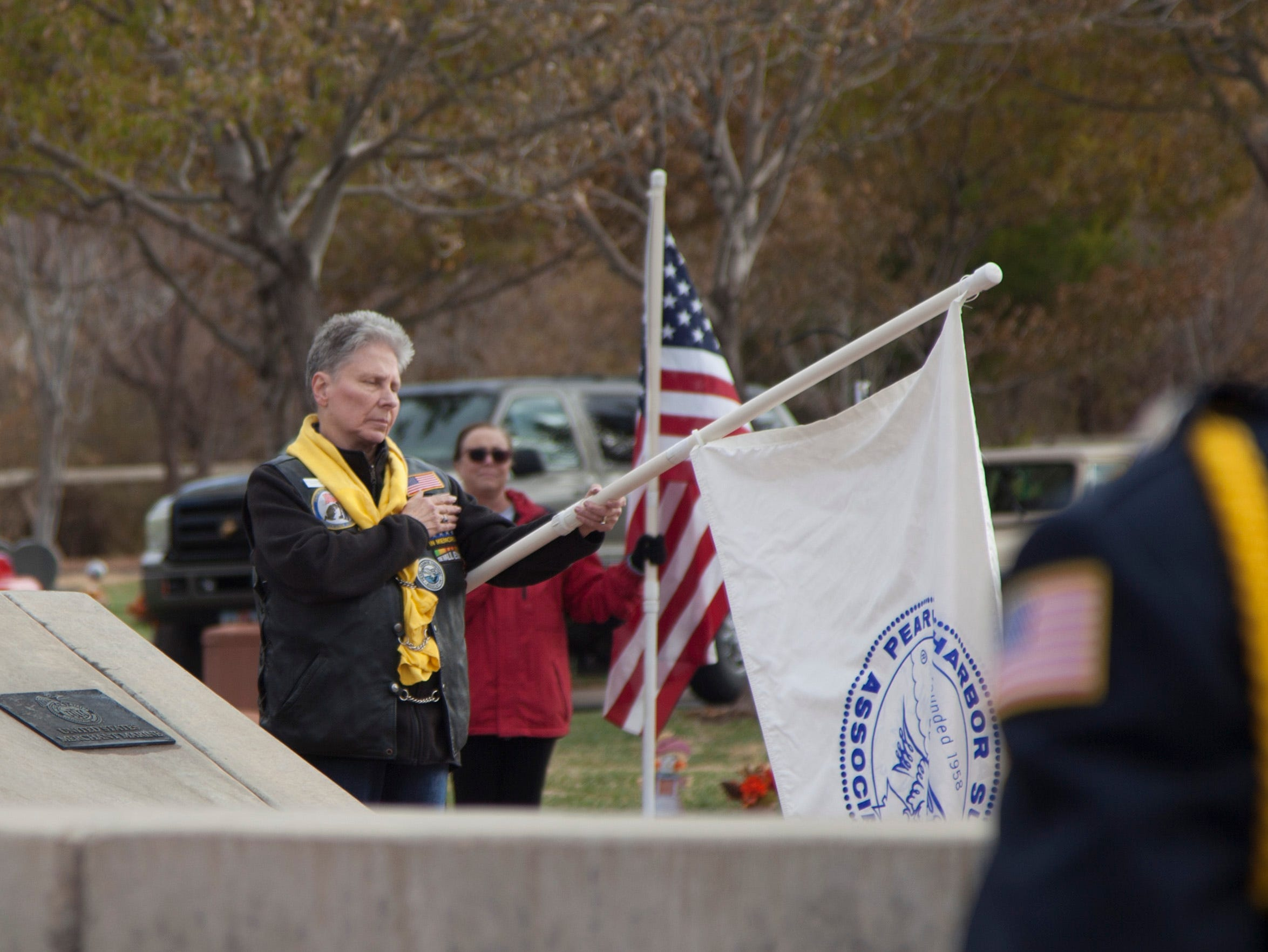 Veterans and members of the community gather to commemorate Pearl Harbor at the Tonaquint Cemetery Friday, Dec. 7, 2018.