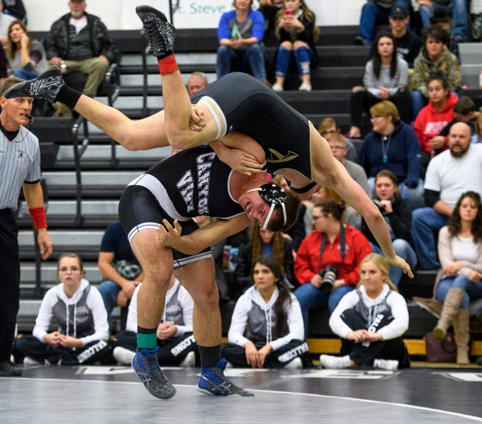 Canyon View's Alex Allen throws his competitor during wrestling duels against Desert Hills at CVHS Thursday, December 6, 2018. The Falcons won 51-25.