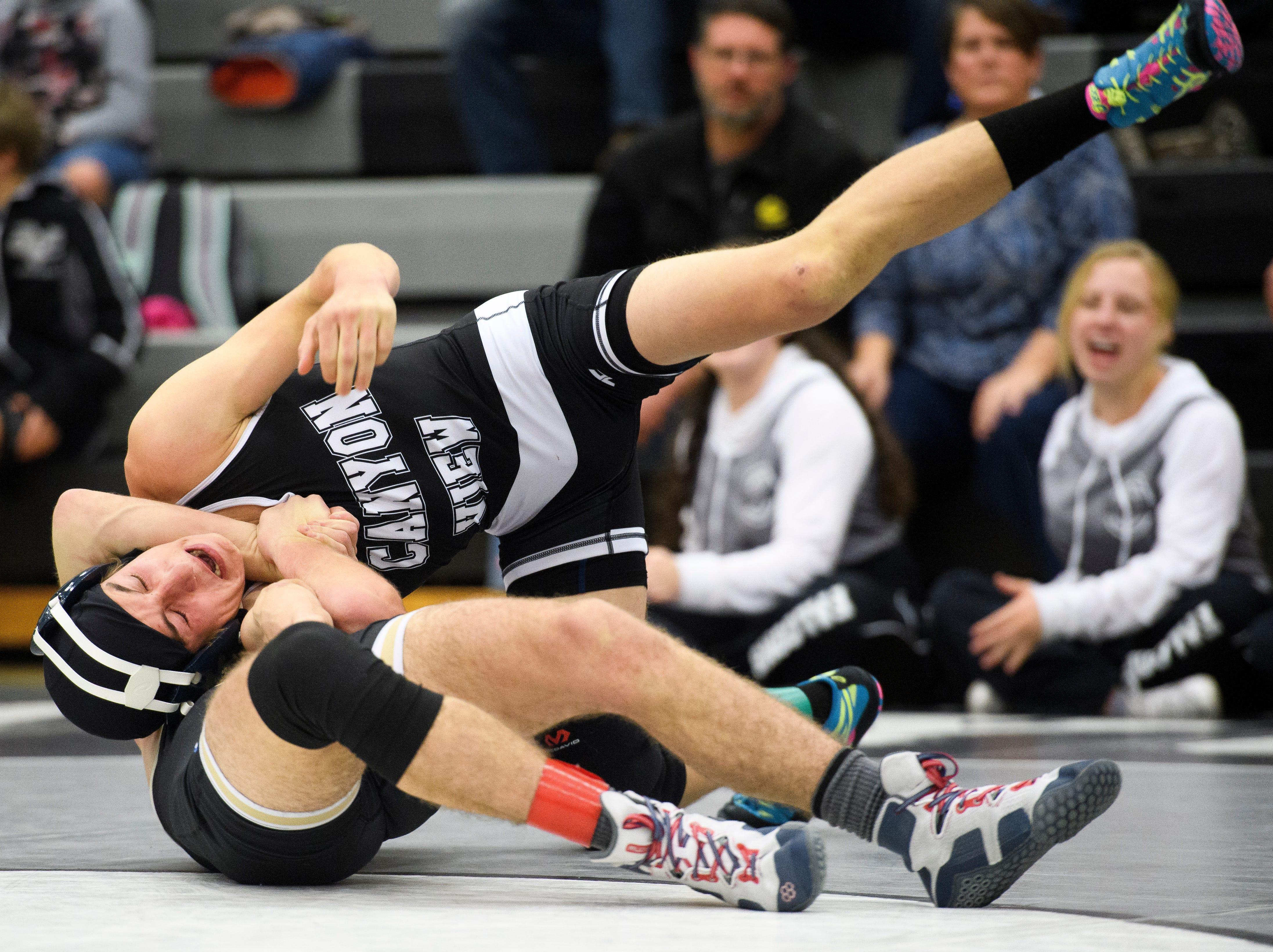 Desert Hills High School wrestler Brody Finlinson flips Canyon View's Garrett Barney at CVHS Thursday, December 6, 2018. The Falcons won, 51-25.