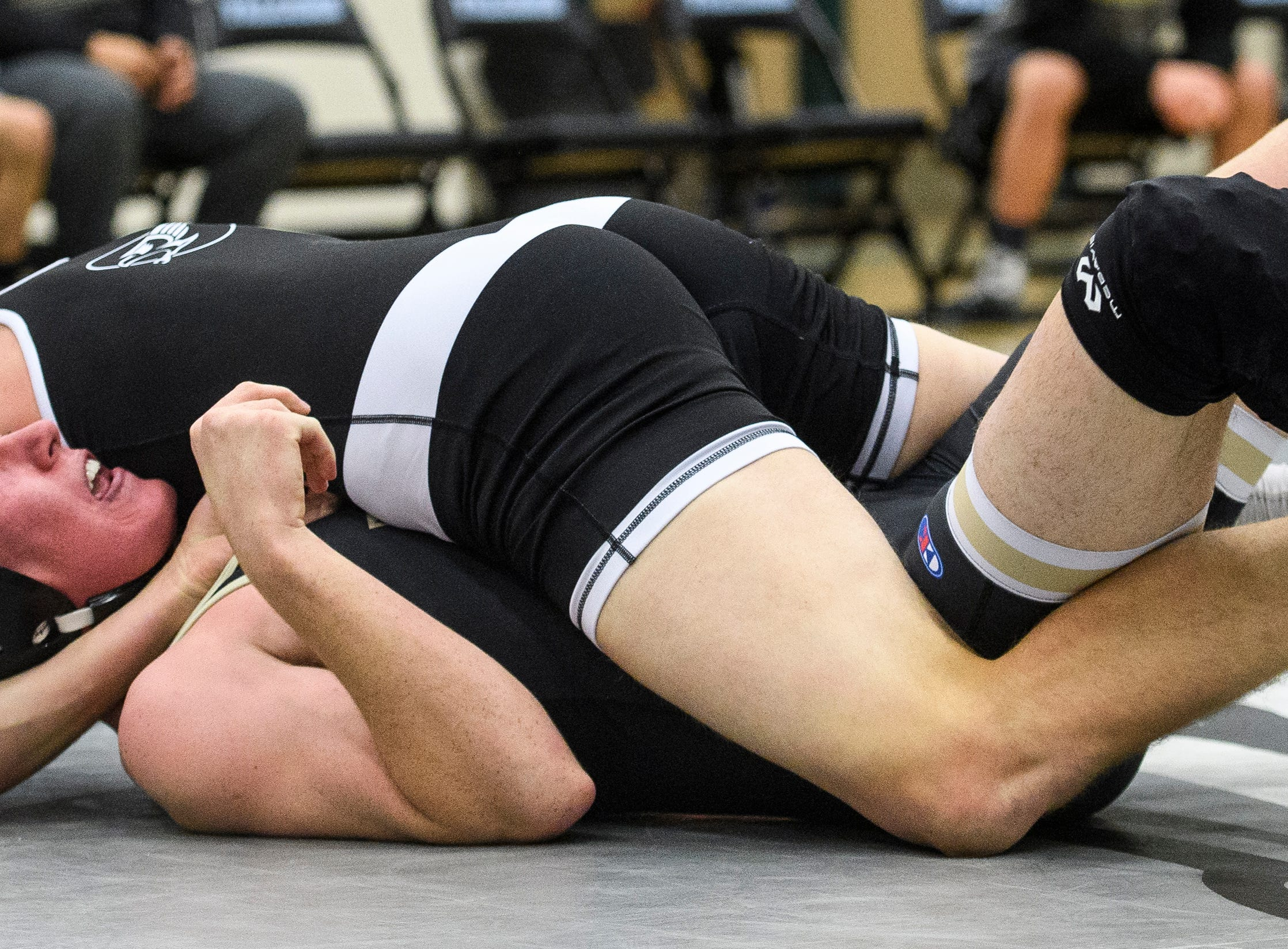Canyon View High School's Colten Shumway gets a pin against Desert Hills at CVHS Thursday, December 6, 2018. The Falcons won, 51-25.