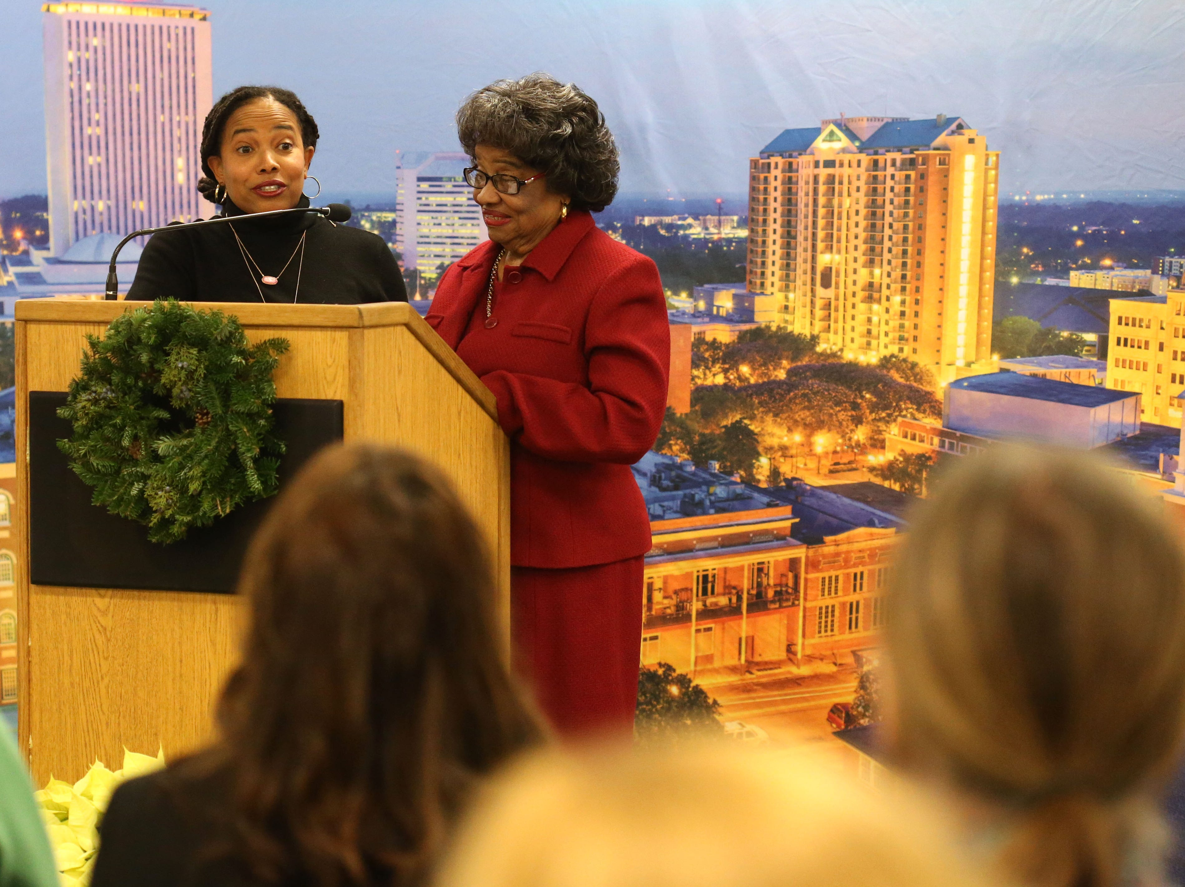 Lucille Alexander, retired professor at the Florida State University College of Nursing, left, and daughter, Aurelia Alexander, professor at FAMU School of Allied Health Sciences, speak at a launch party held at the Tallahassee Democrat for Gerald Ensley's book, 'We Found Paradise,' Thursday, Dec. 6, 2018.