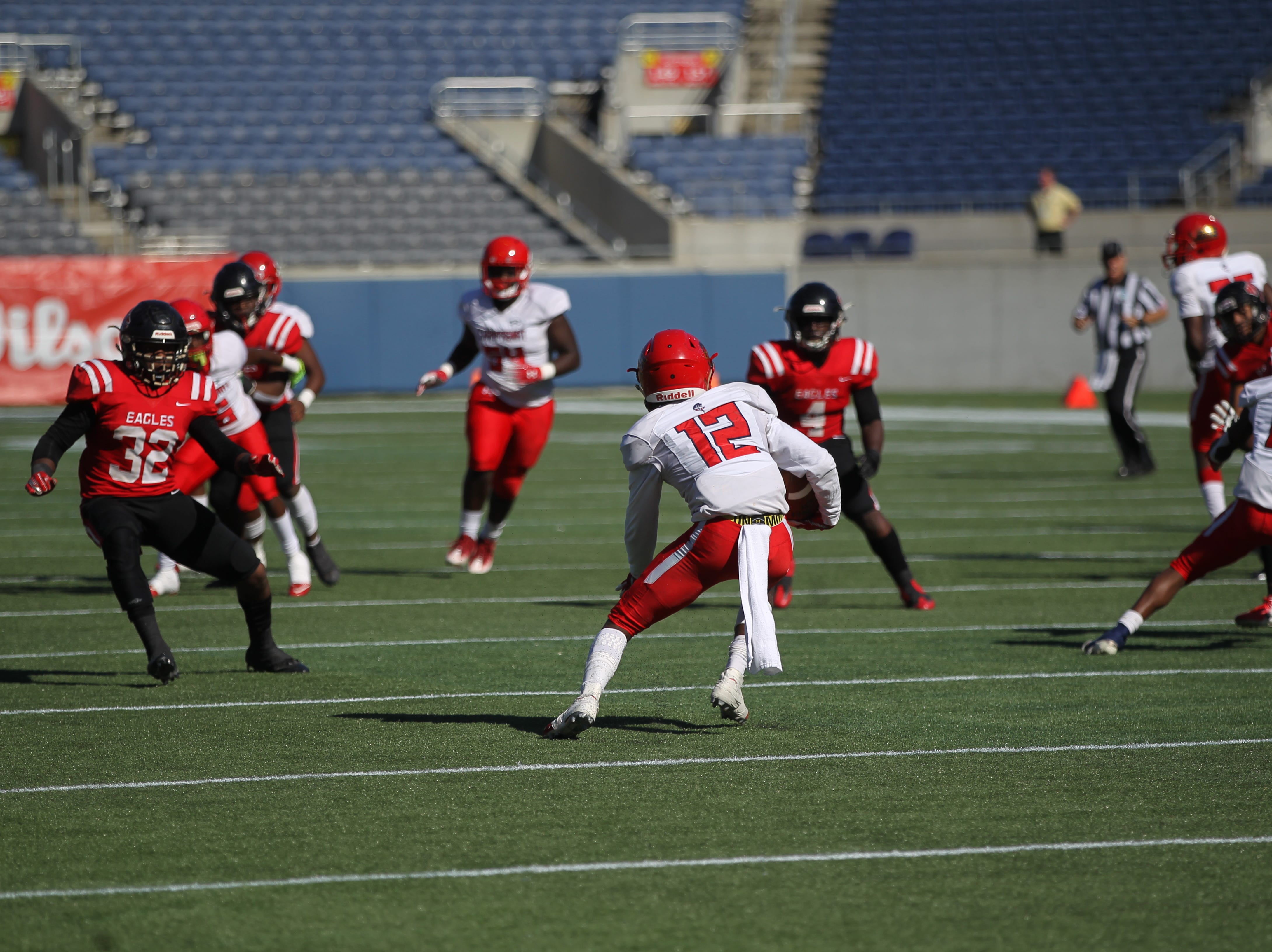 NFC beat Champagnat Catholic 28-20 in a Class 2A state championship game on Friday, Dec. 7, 2018, at Orlando's Camping World Stadium.