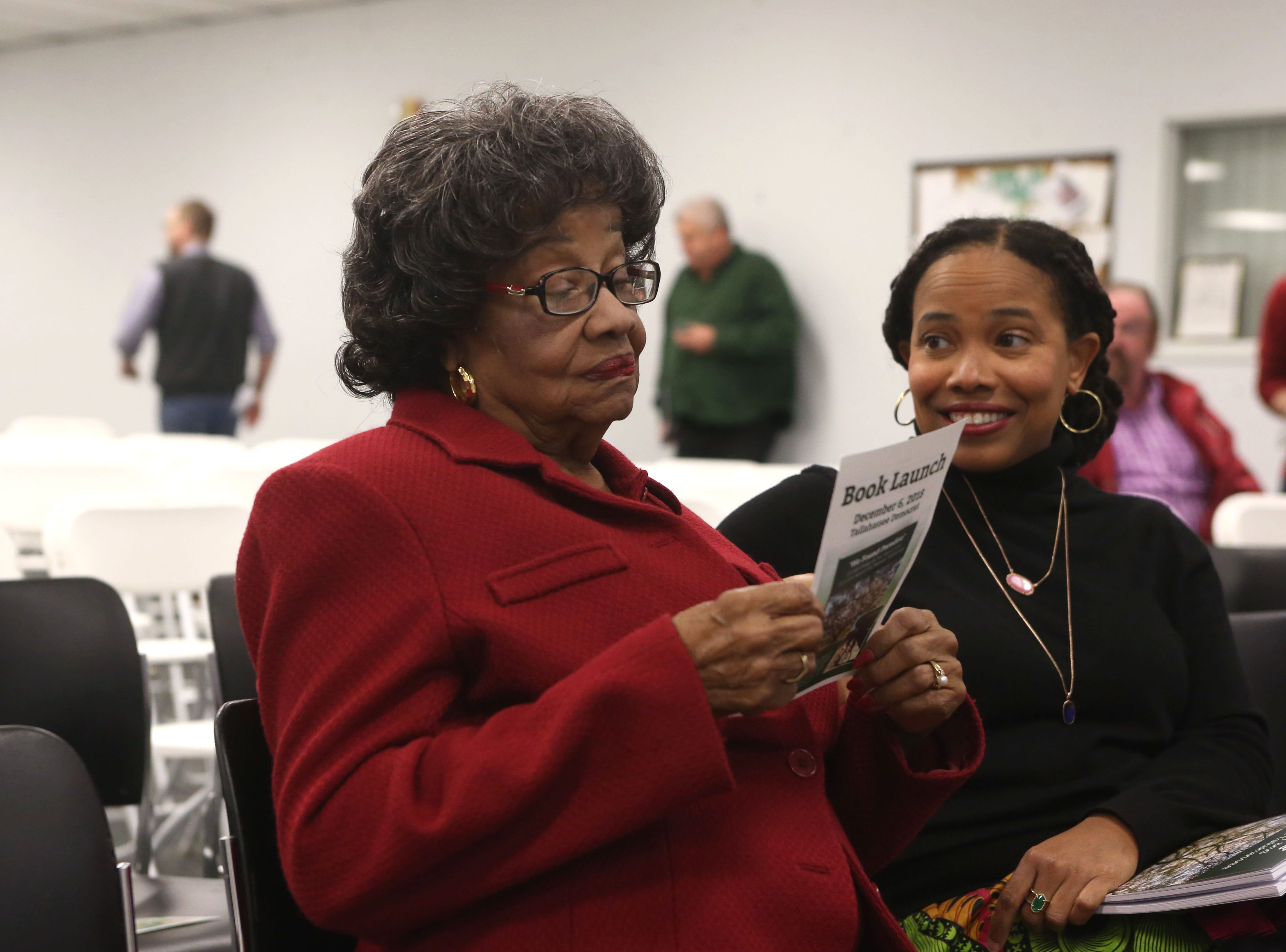 Lucille Alexander, retired professor at the Florida State University College of Nursing, left, and daughter, Aurelia Alexander, professor at FAMU School of Allied Health Sciences, at a launch party held at the Tallahassee Democrat for Gerald Ensley's book, 'We Found Paradise,' Thursday, Dec. 6, 2018.