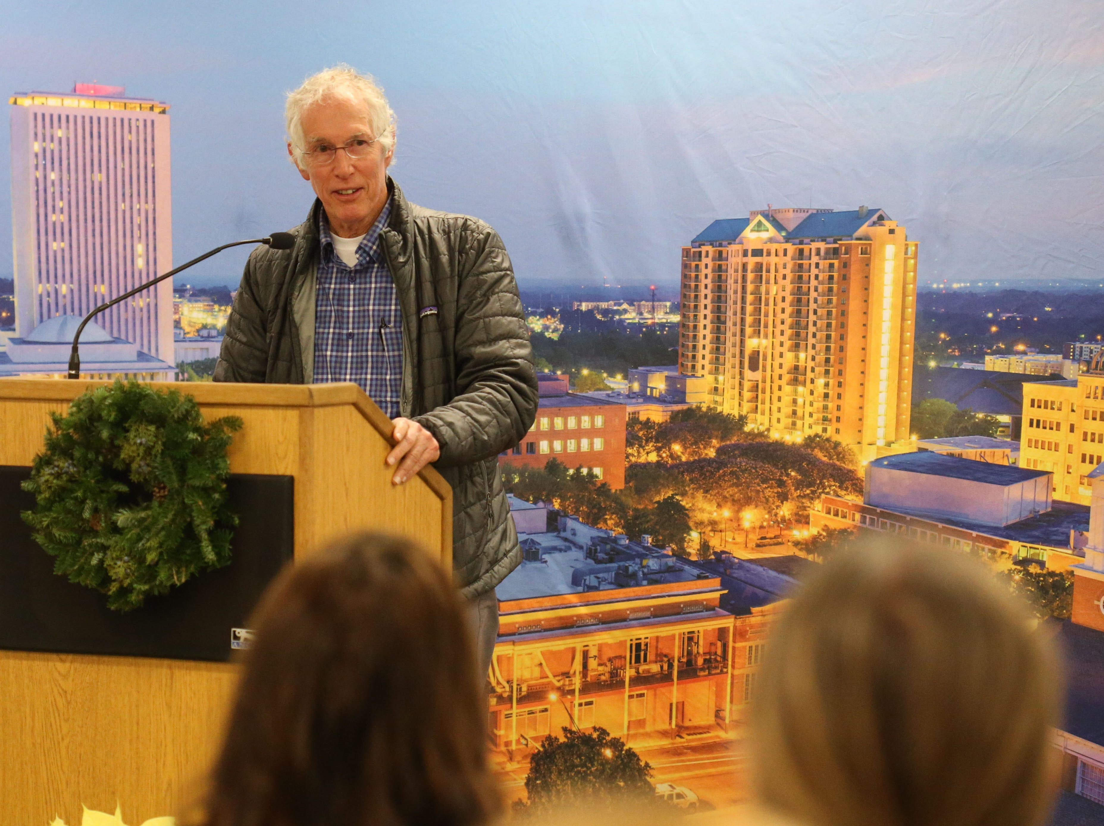 Tommy Warren, former Florida State University athlete and local civil rights attorney, speaks at a launch party held at the Tallahassee Democrat for Gerald Ensley's book, 'We Found Paradise,' Thursday, Dec. 6, 2018.