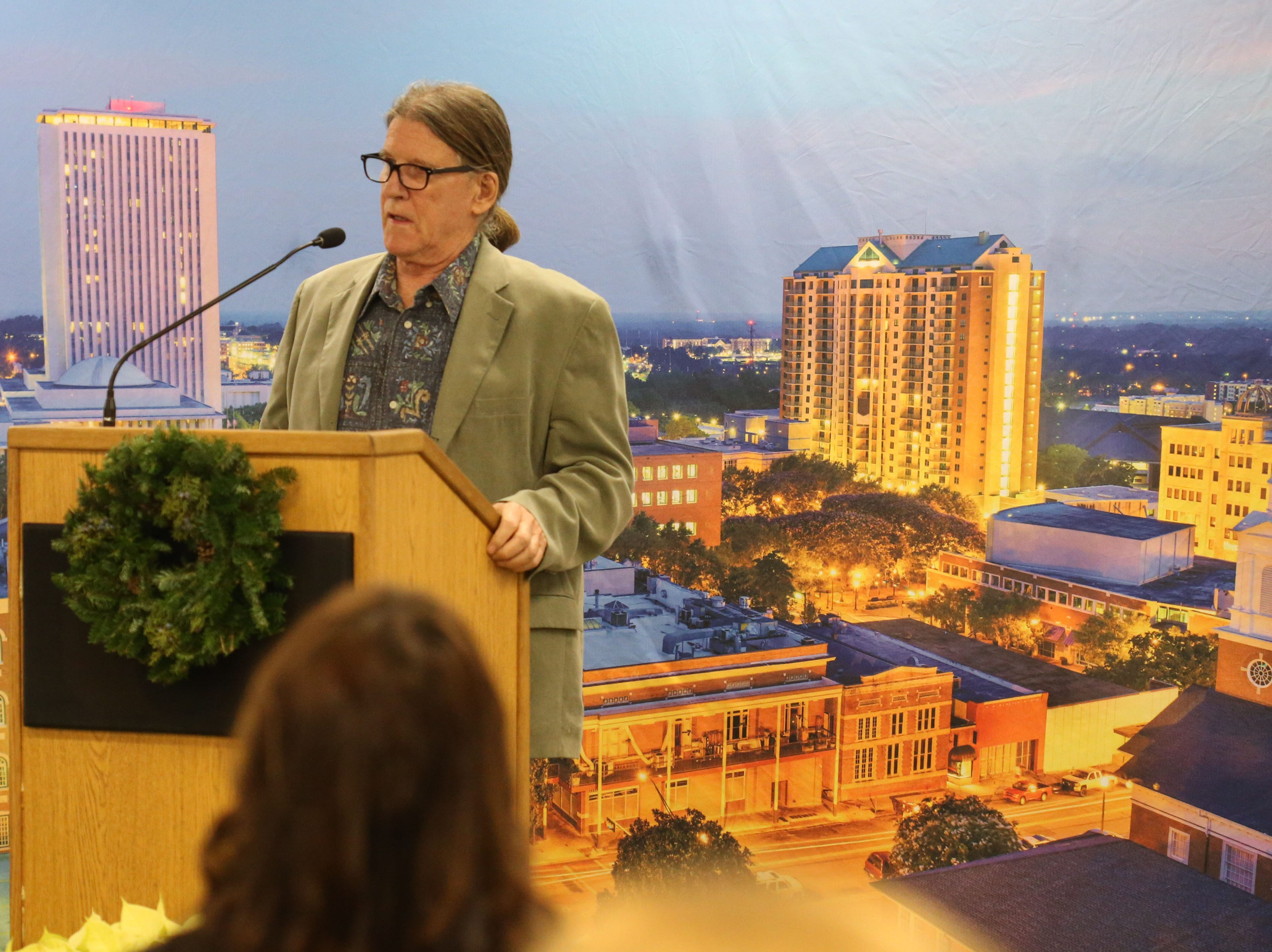 Mike Ferrara, owner of Cabo's Island Grill & Bar, speaks at a launch party held at the Tallahassee Democrat for Gerald Ensley's book, 'We Found Paradise,' Thursday, Dec. 6, 2018.
