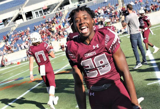 Madison County's Rodderick Johnson celebrates as the Cowboys beat Baker 48-6 in a Class 1A state championship game at Orlando's Camping World Stadium on Thursday, Dec. 6, 2018.
