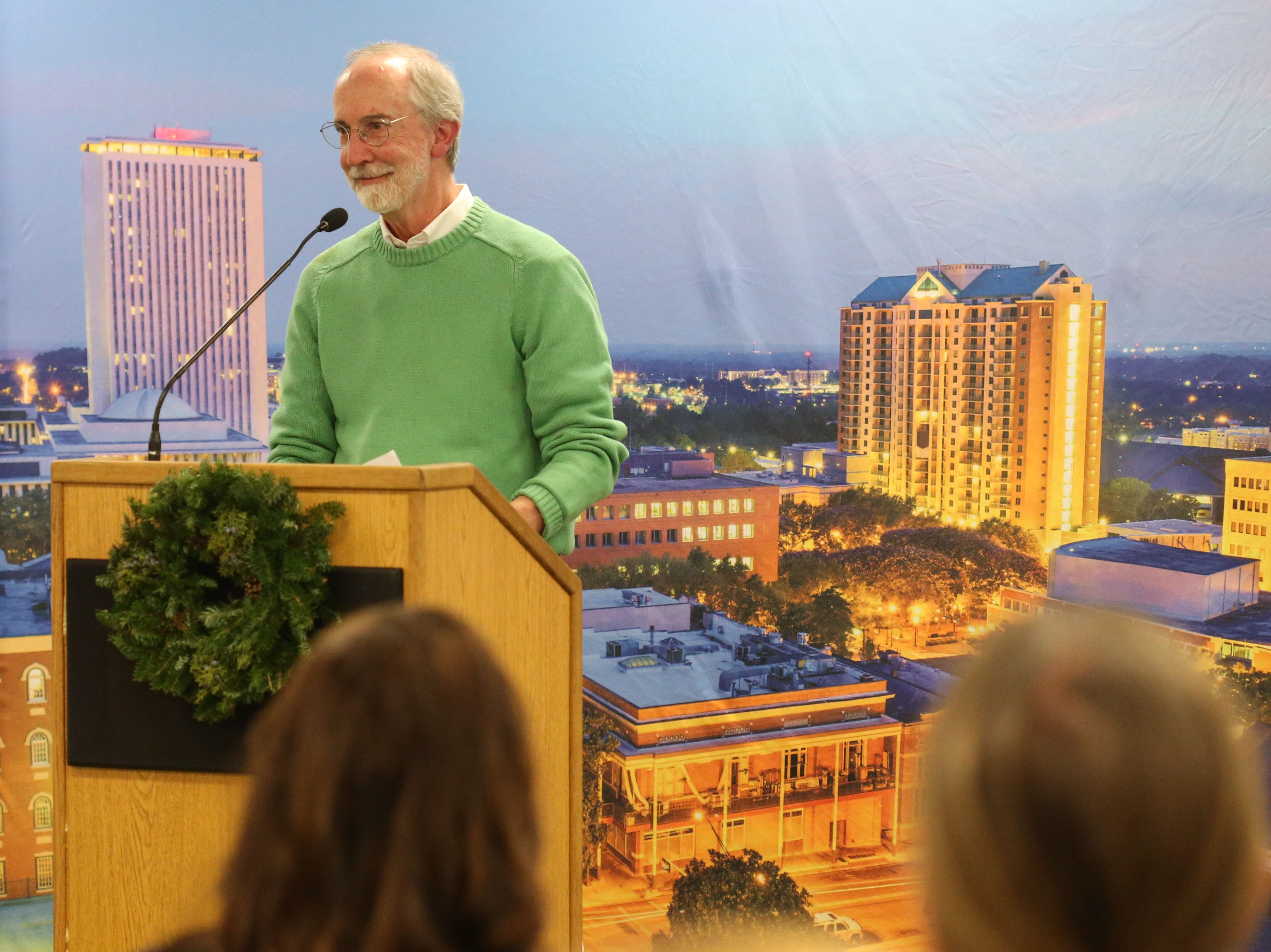 Ron Hartung, assistant director of communications at the Florida State University College of Medicine and former Tallahassee Democrat staff member, speaks at a launch party held at the Tallahassee Democrat for Gerald Ensley's book, 'We Found Paradise,' Thursday, Dec. 6, 2018.