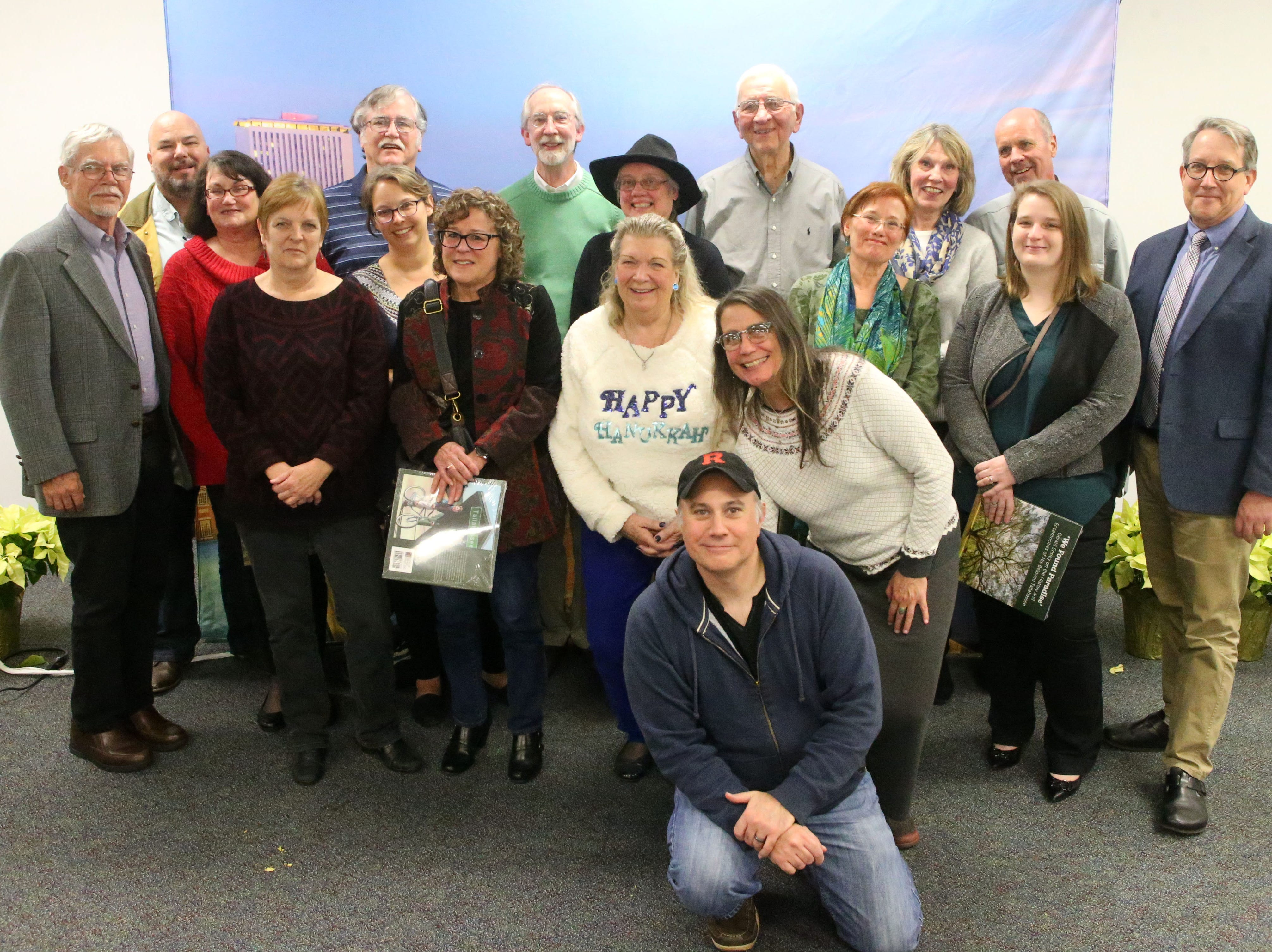 Tallahassee Democrat alumni pose for a photograph at a launch party held at the Tallahassee Democrat for Gerald Ensley's book, 'We Found Paradise,' Thursday, Dec. 6, 2018.
