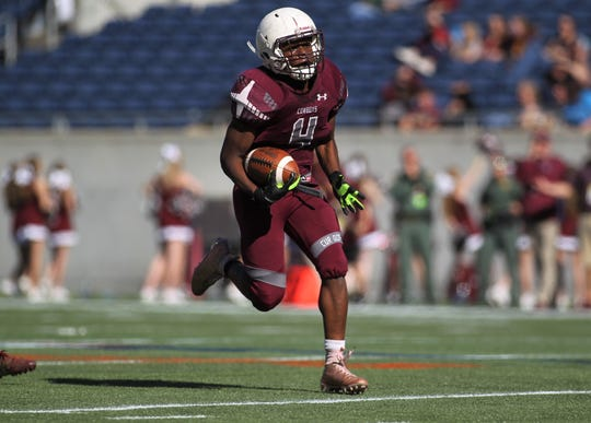 Madison County's Vinsonta Allen breaks a big touchdown run as the Cowboys beat Baker 48-6 in a Class 1A state championship game at Orlando's Camping World Stadium on Thursday, Dec. 6, 2018.