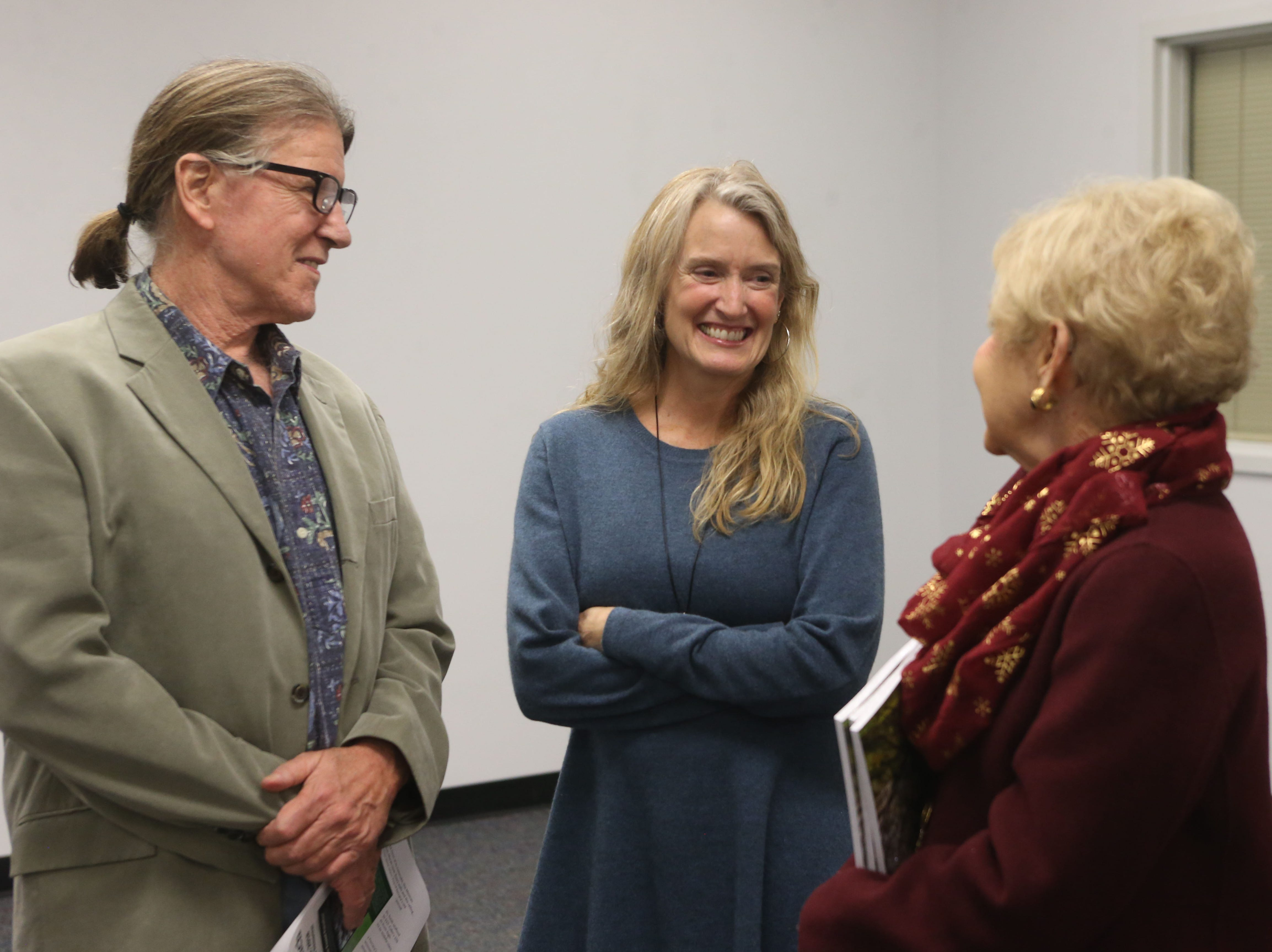 Mike Ferrara, owner of Cabo's Island Grill & Bar, left, with Catherine Ferrara, middle, at a launch party held at the Tallahassee Democrat for Gerald Ensley's book, 'We Found Paradise,' Thursday, Dec. 6, 2018.