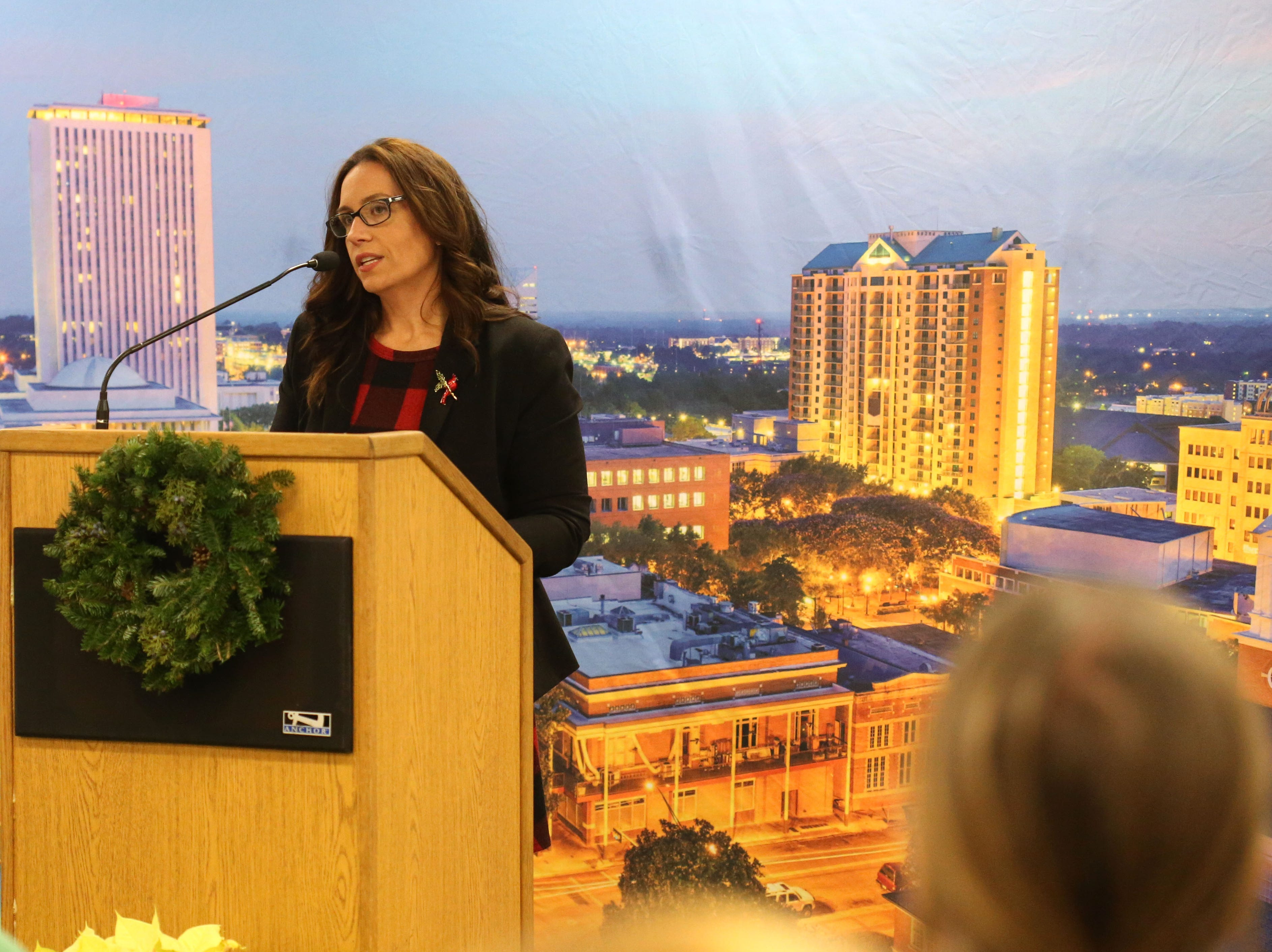 Tiffany Baker, museum director at the Florida Historic Capitol Museum, speaks at a launch party held at the Tallahassee Democrat for Gerald Ensley's book, 'We Found Paradise,' Thursday, Dec. 6, 2018.