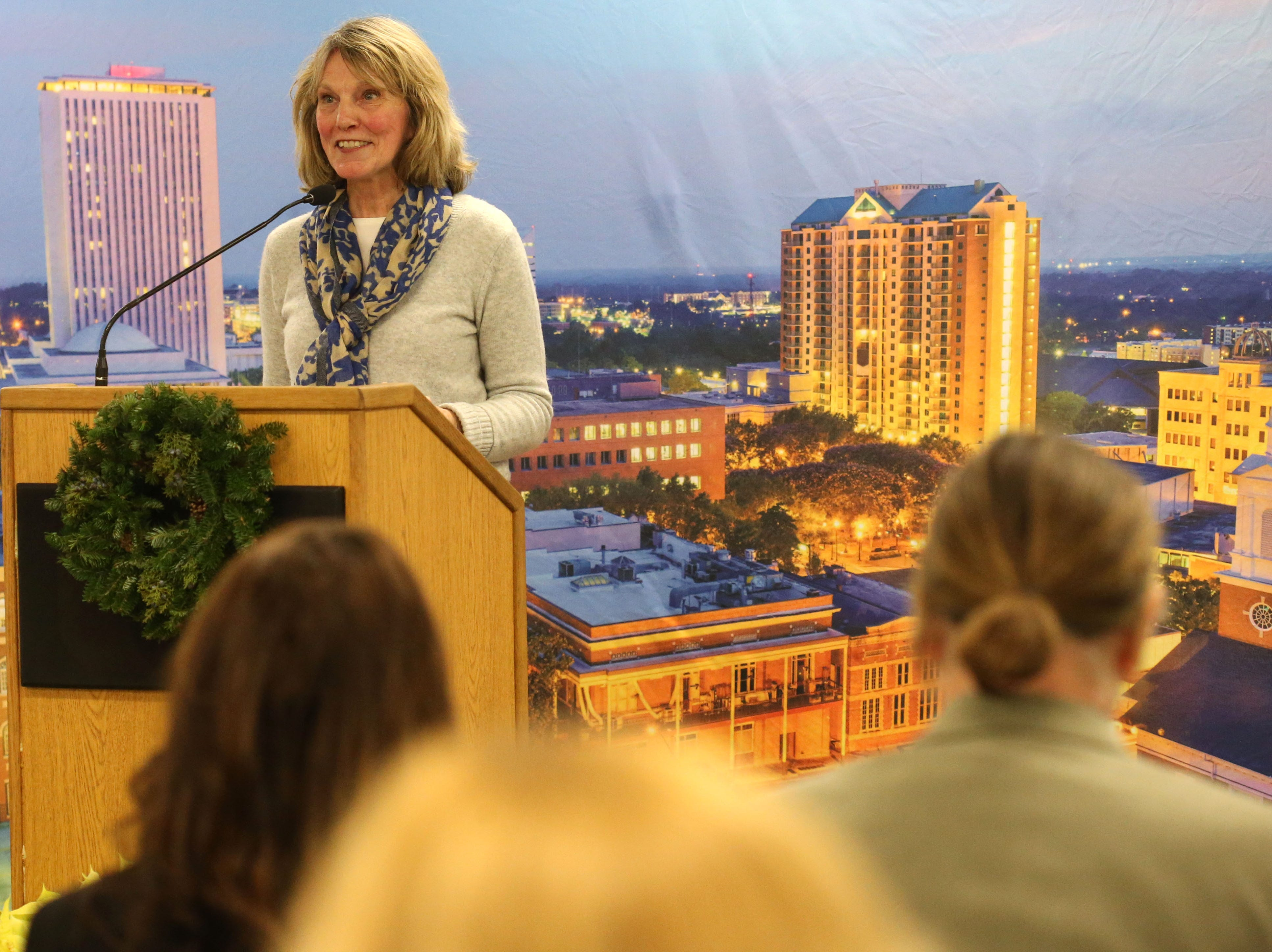 Mary Ann Lindley, Leon County Commissioner and former Tallahassee Democrat staff member, speaks at a launch party held at the Tallahassee Democrat for Gerald Ensley's book, 'We Found Paradise,' Thursday, Dec. 6, 2018.