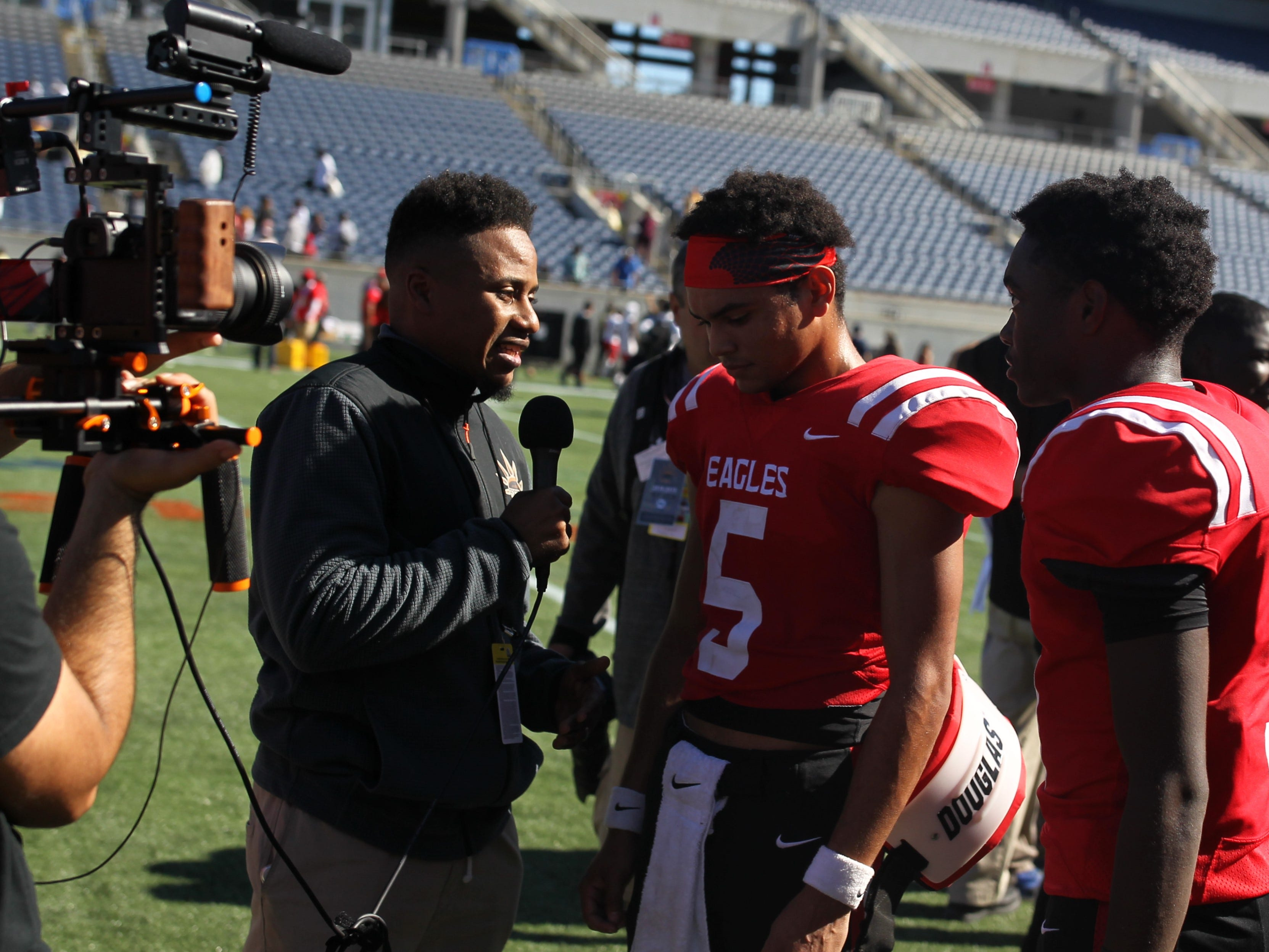 J.D. Jerry gets interviewed after NFC beat Champagnat Catholic 28-20 to win a Class 2A state championship on Friday, Dec. 7, 2018, at Orlando's Camping World Stadium.