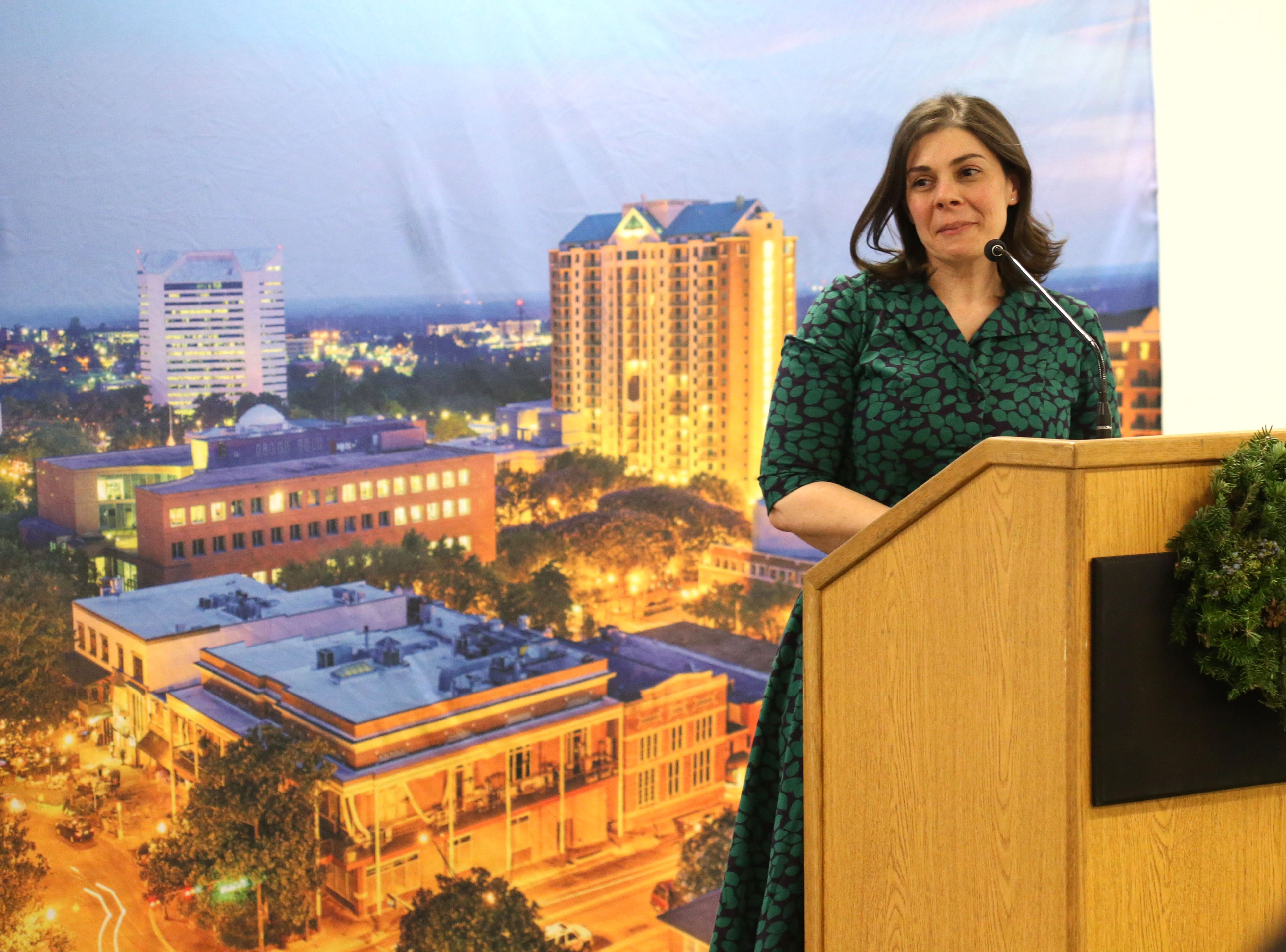 Amanda Karioth Thompson, daughter of Gerald Ensley, speaks at a launch party held at the Tallahassee Democrat for Gerald Ensley's book, 'We Found Paradise,' Thursday, Dec. 6, 2018.