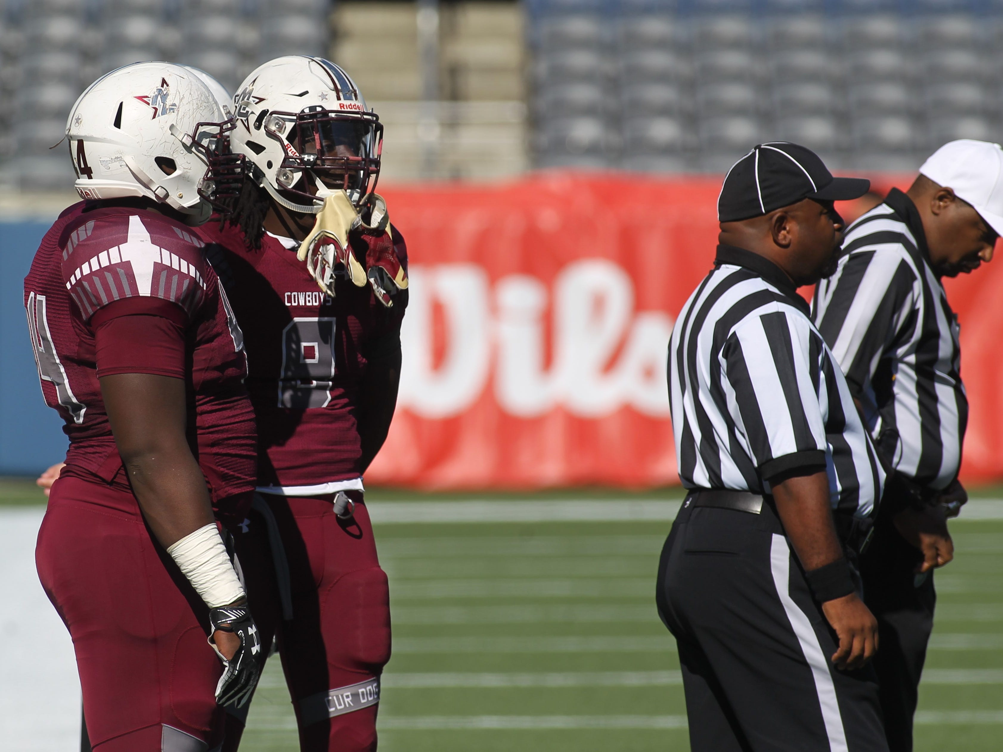 Madison County captains Terray Jones (44) and Travis Jay (8) wait for the coin toss prior to the Cowboys beating Baker 48-6 in a Class 1A state championship game at Orlando's Camping World Stadium on Thursday, Dec. 6, 2018.