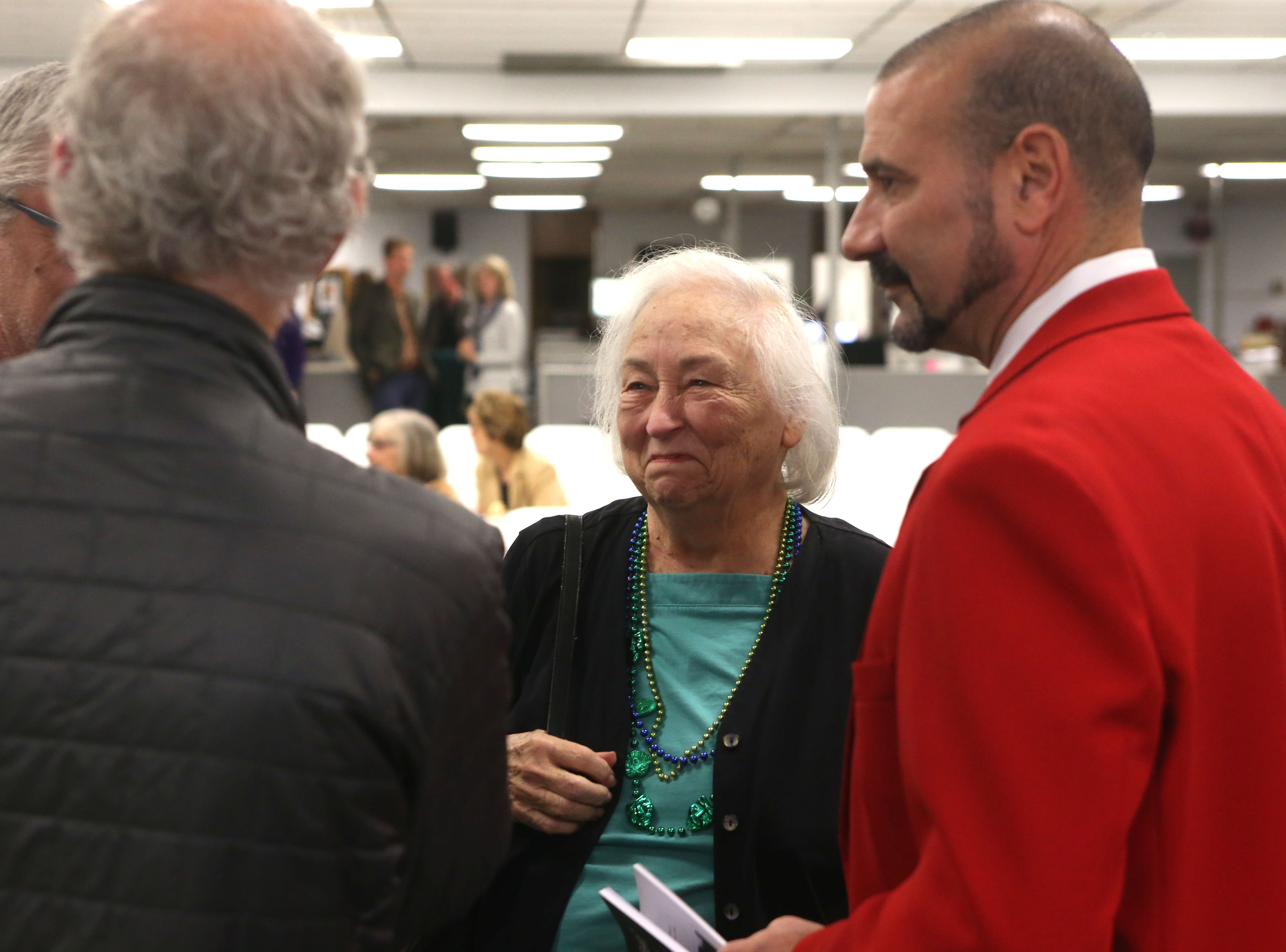 Many gather for a launch party held at the Tallahassee Democrat for Gerald Ensley's book, 'We Found Paradise,' Thursday, Dec. 6, 2018.