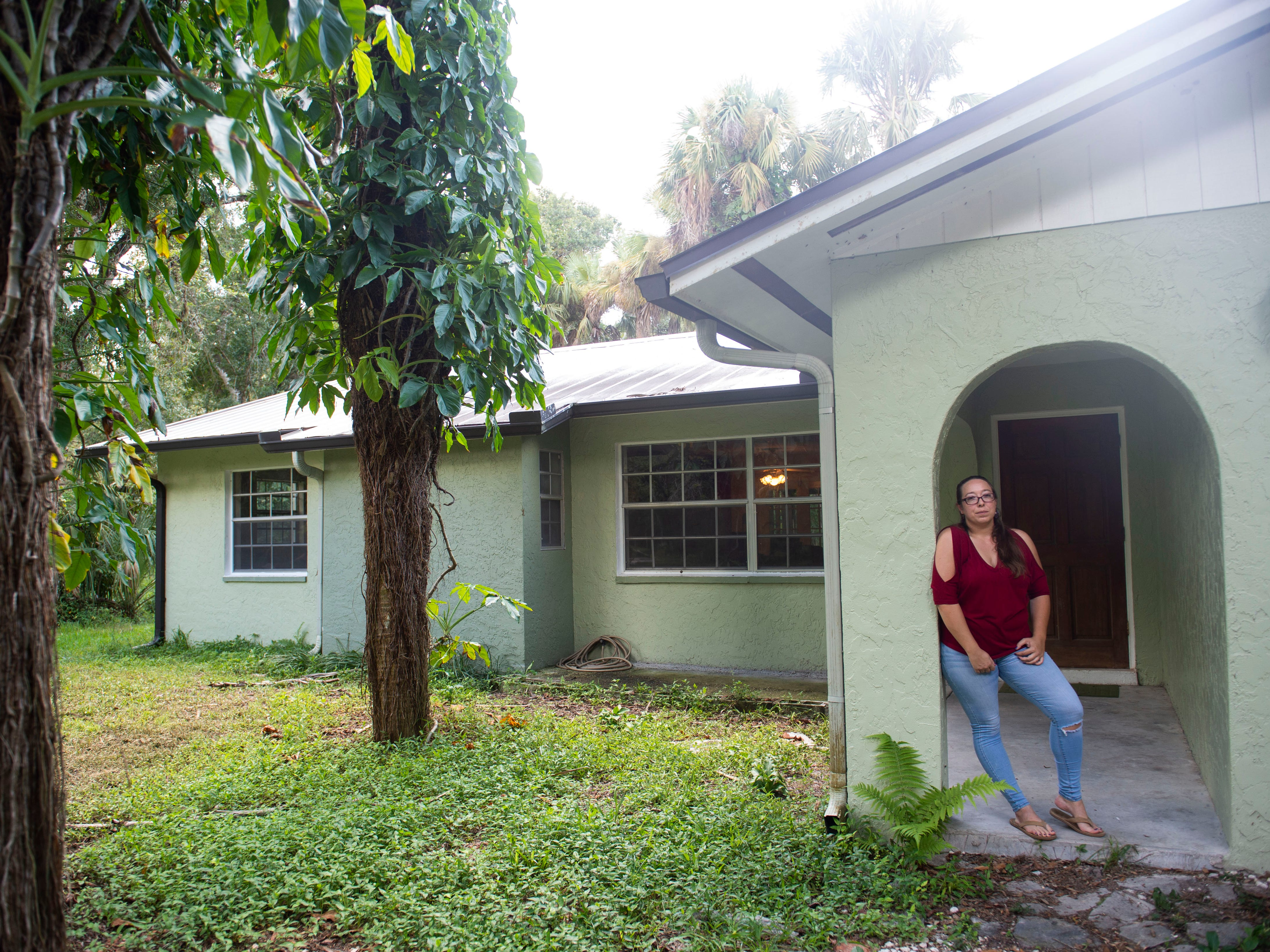 """Following Hurricane Irma in Sept. 2017, the interior of Courtney Crowley's home was covered in 11 inches of water, causing $90,000 in damage, excluding personal belongings. When Crowley and her husband were able to make their way back to their property several days after Irma's landfall, they had to jimmy a window open to enter the house, then kick the front door open. """"You could see water still on the floor. The couches were all soaked. All of my mattresses were ruined, most of my clothes, almost all of my furniture. I mean everything. We threw out everything,"""" Crowley said. The Crowley's moved back into their home in May and are slowly collecting new possessions."""