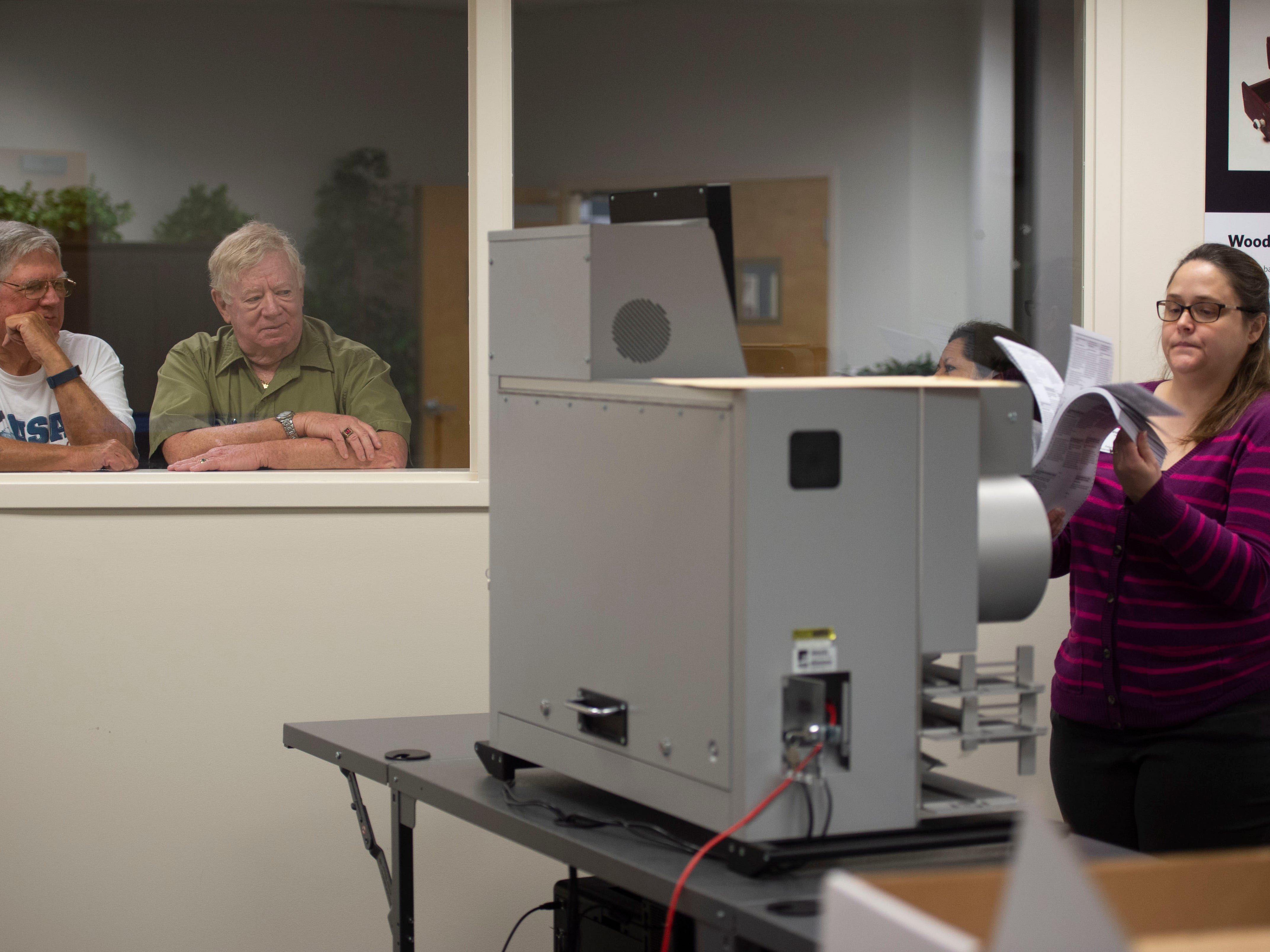 """Observers Hank Lippe (left) and Fred Grumman, both of Vero Beach, watch Maureen Houssell, chief deputy of operations for the Indian River County Supervisor of Elections, during a recount of 74,992 ballots on Nov. 11, 2018 at the county's elections office in Indian River County. Secretary of State Ken Detzner ordered recounts in the elections for governor, U.S. Senator and agriculture commissioner because the results provided to the state from the margin from all three races were less than one-half of one percent. """"That's a wonderful way to spend a Sunday,"""" said Grumman, laughing. """"You do your civic duty. It sound cliche, but if you believe in the process and they need you, you do it."""""""