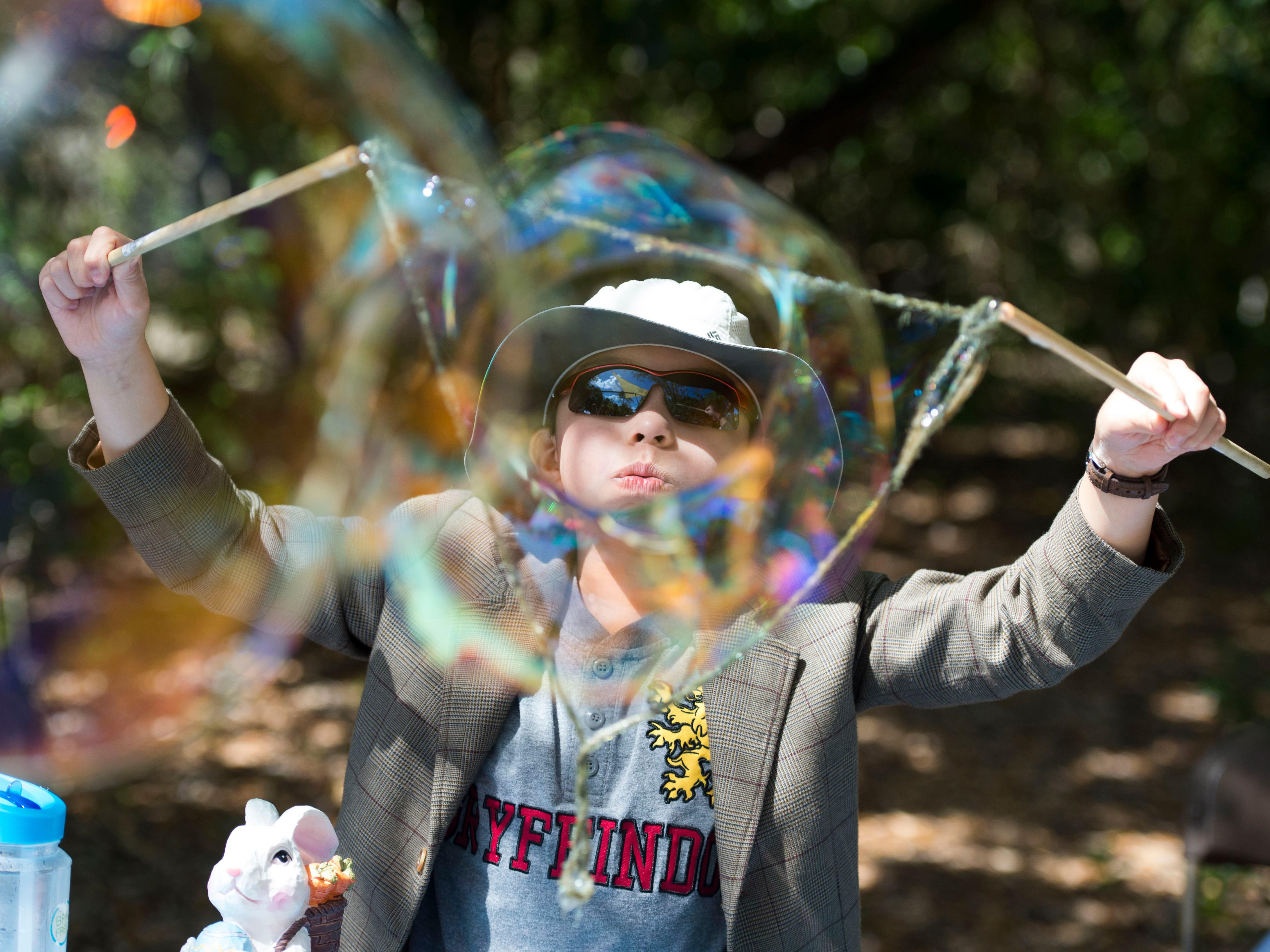 """Hunter Cook, 9, of Vero Beach, blows a homemade bubble March 4, 2018, during the 22nd annual EcoFest at the Environmental Learning Center in Vero Beach. """"I can just hold it up and watch the bubbles be formed,"""" Cook said. The event offered nature education booths, touch tank encounters, live music, crafts, adult workshops and more."""