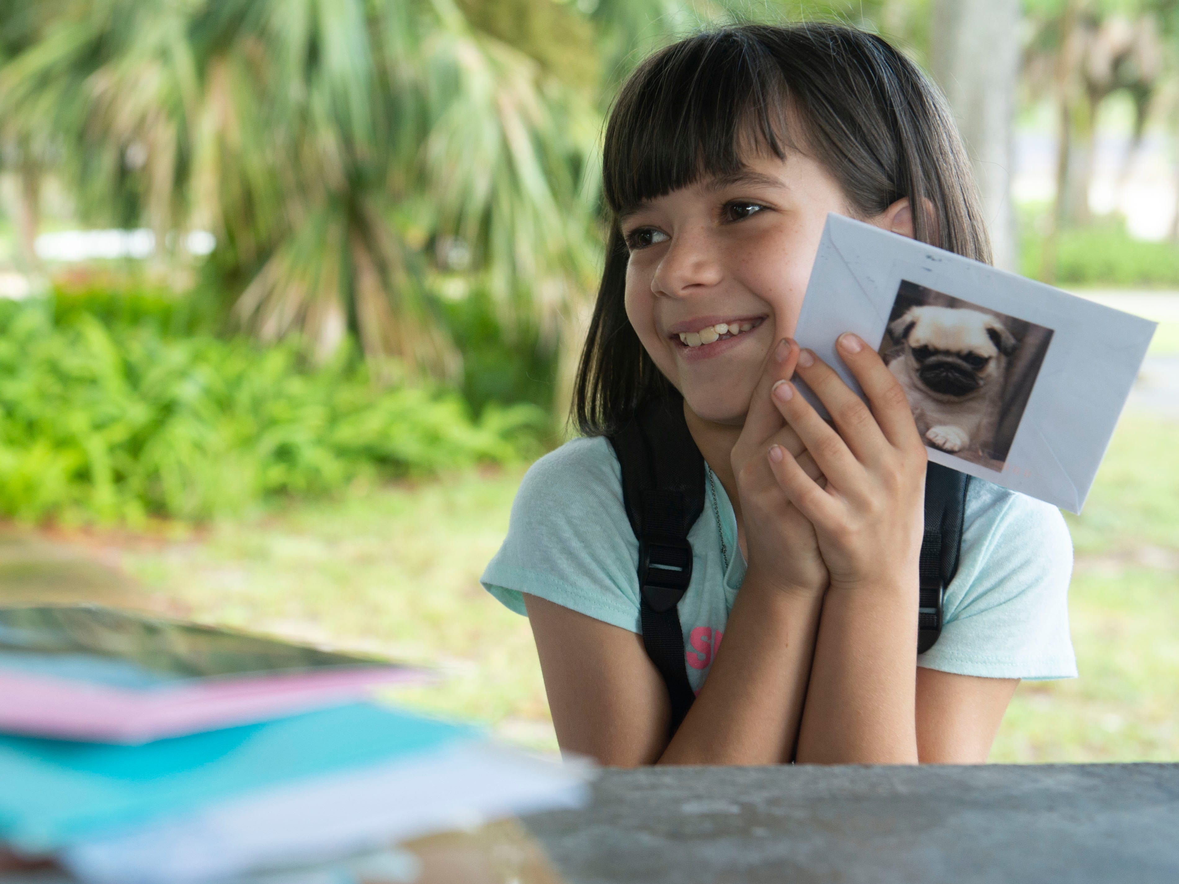 """""""I screamed when I saw it was a pug,"""" said Halee Doud, 8, of Vero Beach, on Sept. 21, 2018 when she saw a card from a well-wisher with a pug sticker on the back. Doud spends much of her life in a hospital and has a variety of medical issues, including an irregular heartbeat, a feeding tube and multiple allergies. For her ninth birthday on Oct. 8, her mother, Tabitha Doud, has requested well-wishers send cards to Halee Doud, P.O. Box 651517, Vero Beach, FL 32965. """"It gives me a smile and makes me feel happy,"""" Halee Doud of receiving cards."""