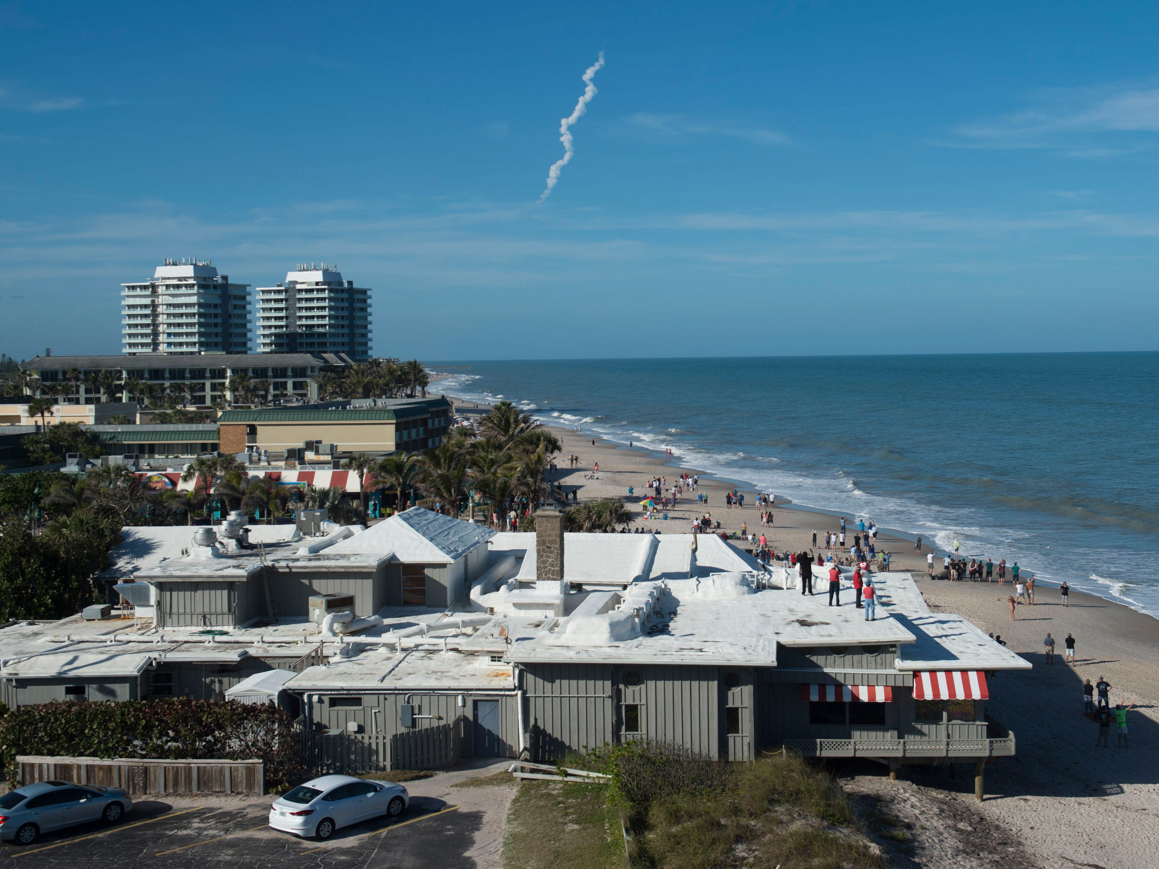 With a Tesla Roadster attached and a dummy named Starman in the driver's seat, Space X's Falcon Heavy spacecraft rocketed into space to the delight of observers on the beach Feb. 6, 2018, seen from the roof of Costa d'Este Beach Resort in Vero Beach. Space X founder Elon Musk hopes the Falcon Heavy will float in elliptical orbit between Earth and Mars for about a billion years.