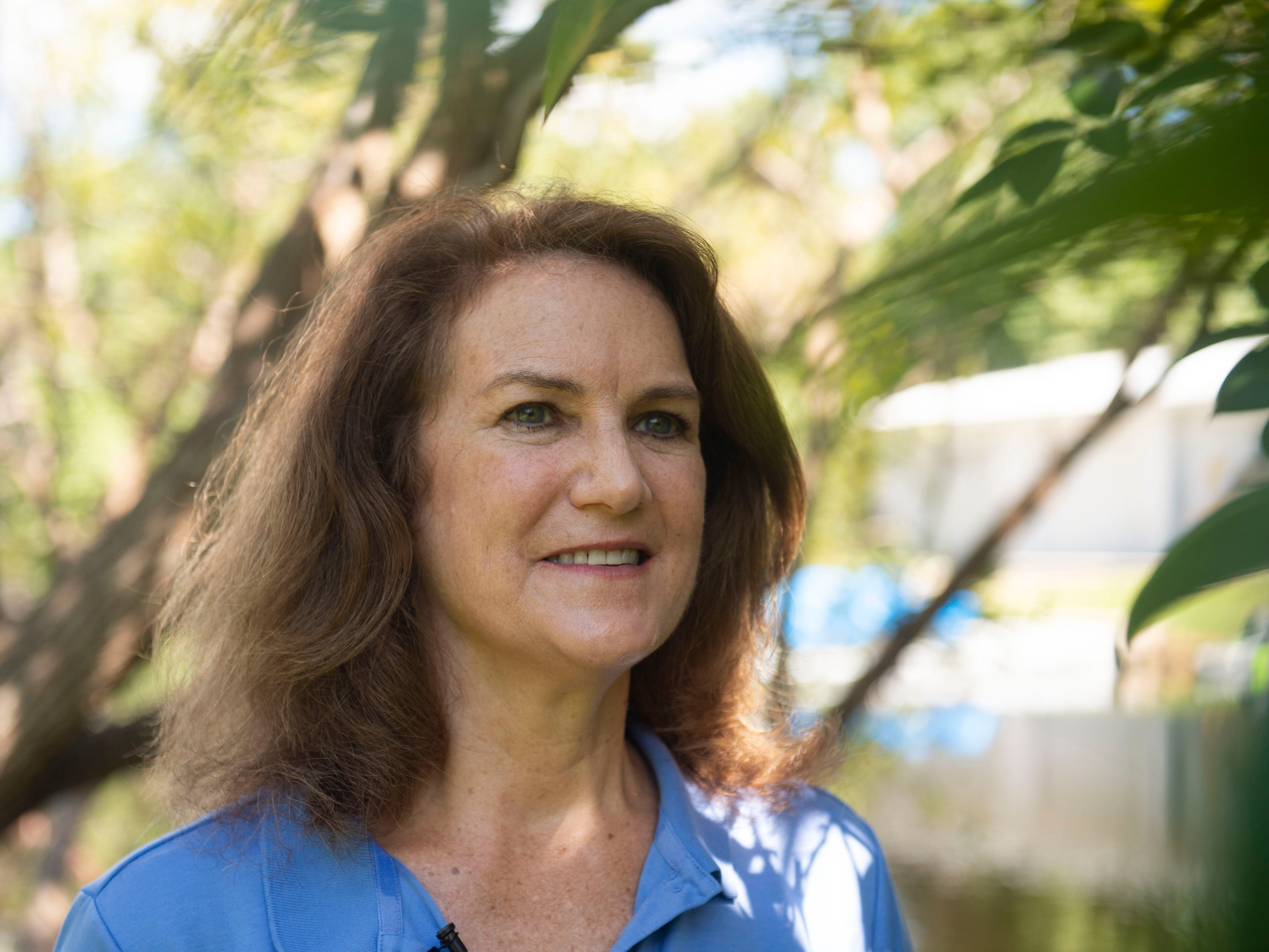 """Laura Geselbracht, 59, of Fort Lauderdale, is a senior marine scientist at The Nature Conservancy who is concerned about climate change, sea level rise and coastal resiliency this election year. Geselbracht hopes to see individuals, all levels of governments, corporations and small businesses making an effort to battle climate change. """"It's amazing what we can accomplish when we put our mind to it. But if we're just avoiding the problem, that's not helping anybody over the long term,"""" she said."""