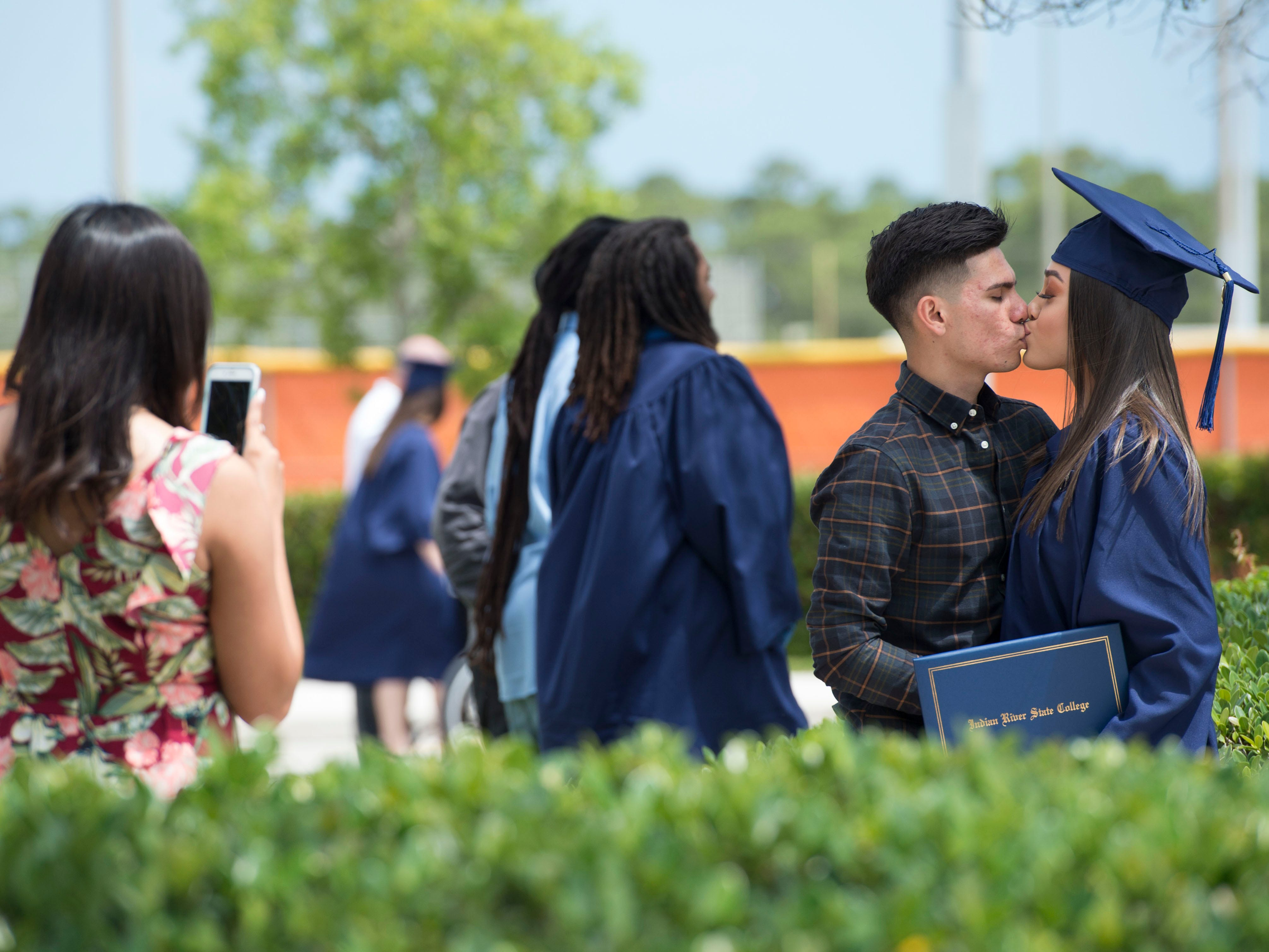 """Josh Gamez, of Fort Pierce, kisses his girlfriend, graduate Jocelyn Falcon, of Port St. Lucie, after more than 400 students earned associate degrees at the first of Indian River State College's four commencement ceremonies May 3, 2018 at the Havert L. Fenn Center in Fort Pierce. In total, the college graduated nearly 4,000 students, the largest class in the school's history. """"You're a special class in a lot of ways,"""" said Edwin Massey, president of Indian River State College. """"What you have become today is a college graduate. Take those skills... and you will be unstoppable."""""""