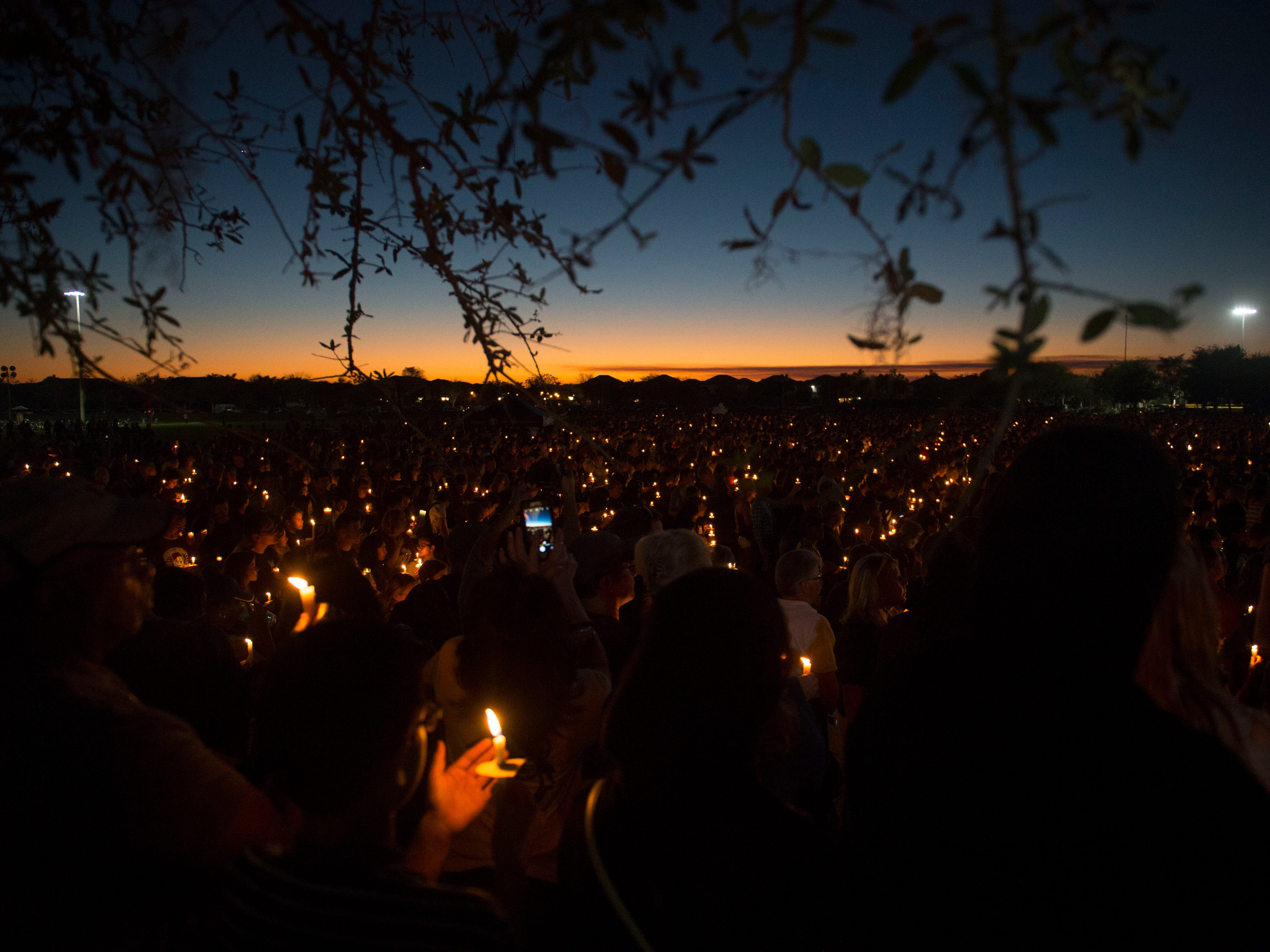 At least 8,000 people gathered Feb. 15, 2018 at Pine Trails Park Amphitheater in Parkland for a candlelight vigil to honor the 17 students and faculty lost in the Valentine's Day shooting at Marjory Stoneman Douglas High School.
