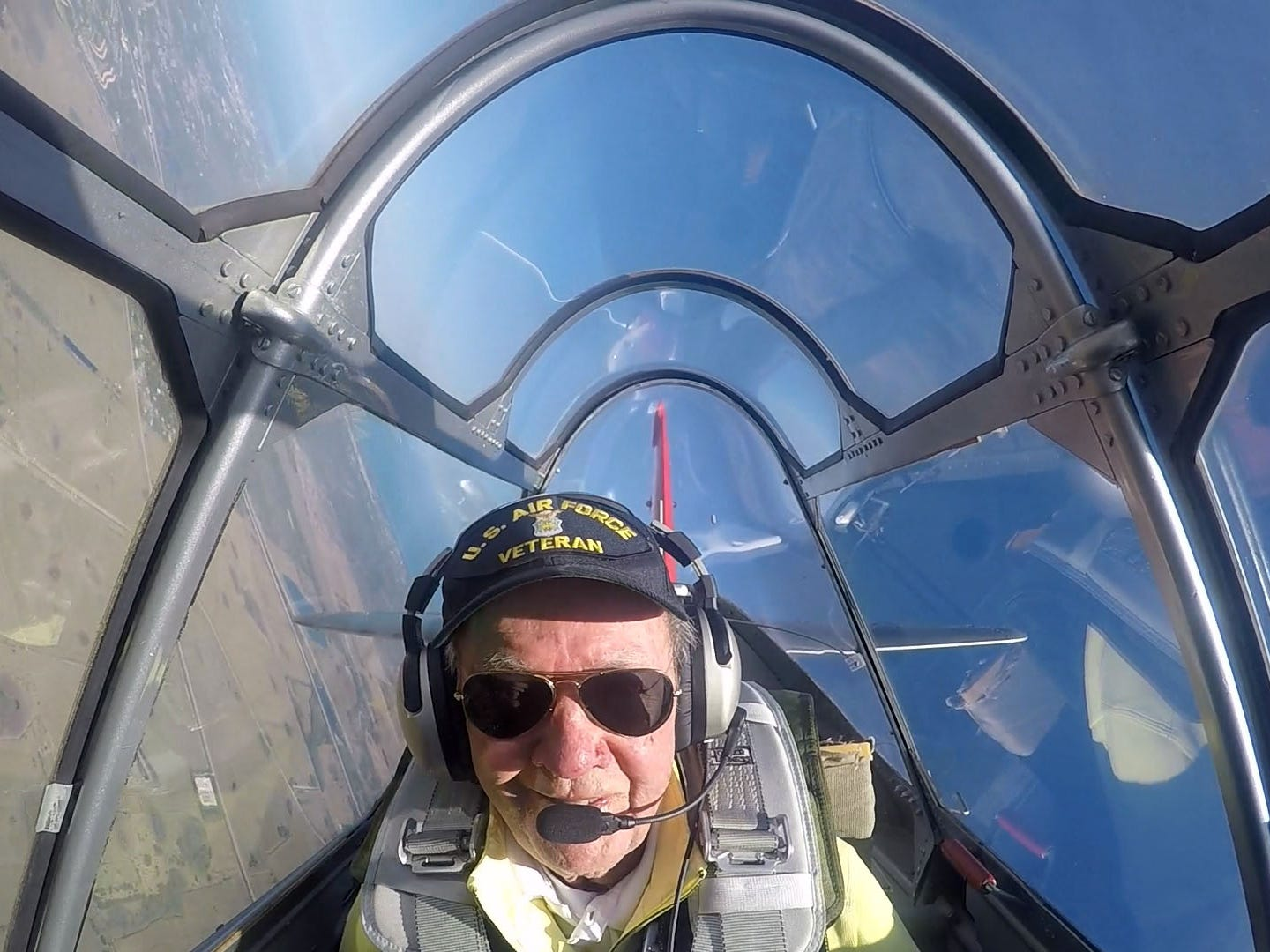 """""""Flying stays with you. Like you learn how to ride a bicycle, you never forget,"""" said retired Air Force 1st Lt. Alyn Bell, a seasonal resident of Palm City, who celebrated his 94th birthday a day early by taking a ride in Dr. Shawn Engebretsen's Navy SNJ-6 World War II trainer plane, on March 18, 2018, flying over Martin County. Bell flew a B-25 Mitchell in World War II while stationed in Guadalcanal, New Guinea and the Philippines over three years, beginning in December 1944. The veteran flew in 24 combat missions, escorted the chorus line of the """"Oklahoma!"""" musical for a United Service Organizations performance and safely landed a bomber that ran out of gas in the jungle of New Guinea. """"Everybody walked away without a scratch,"""" Bell said."""