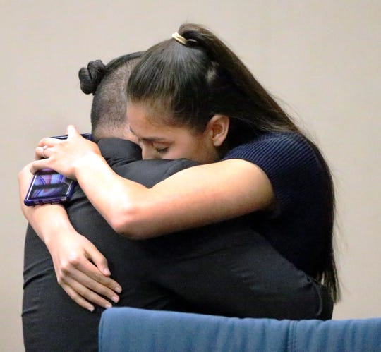 Reniery Adalberto Galeano is hugged by loved ones following his acquittal on the charge of aggravated assault with a deadly weapon Thursday in 168th District Court.