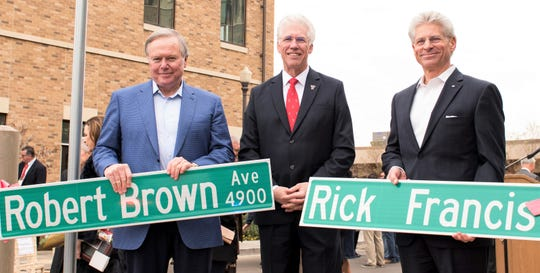El Paso businessmen Robert Brown and Rick Francis stand with Texas Tech University Health Sciences Center El Paso President Richard Lange at a Dec. 7  street naming ceremony.