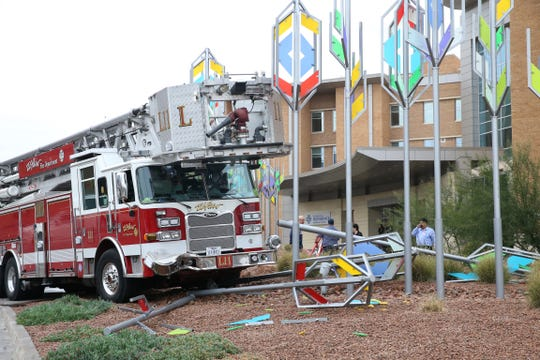 An El Paso Fire Department ladder truck on Friday sits partially on the front area of The Hospitals of Providence Memorial Campus at 2001 N. Oregon St. after it apparently rolled down the street a short distance from where it originally was parked. According to a police officer on the scene, the vehicle was parked in front of University Towers at 1900 N. Oregon St. The crew evidently had exited the vehicle when it began to roll down the street, coming to rest in front of the hospital after hitting an art installation located there. The installation was damaged, as was a streetlamp post. The vehicle had visible damage to the front bumper. No one was injured, and the driver was cited for failure to control the vehicle, the officer said.