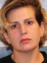 This undated photo provided by the Tulare County Sheriff's office shows Heather Langdon. Police have arrested Langdon in central California after her twin 10-month-old sons were found drowned in a motel.