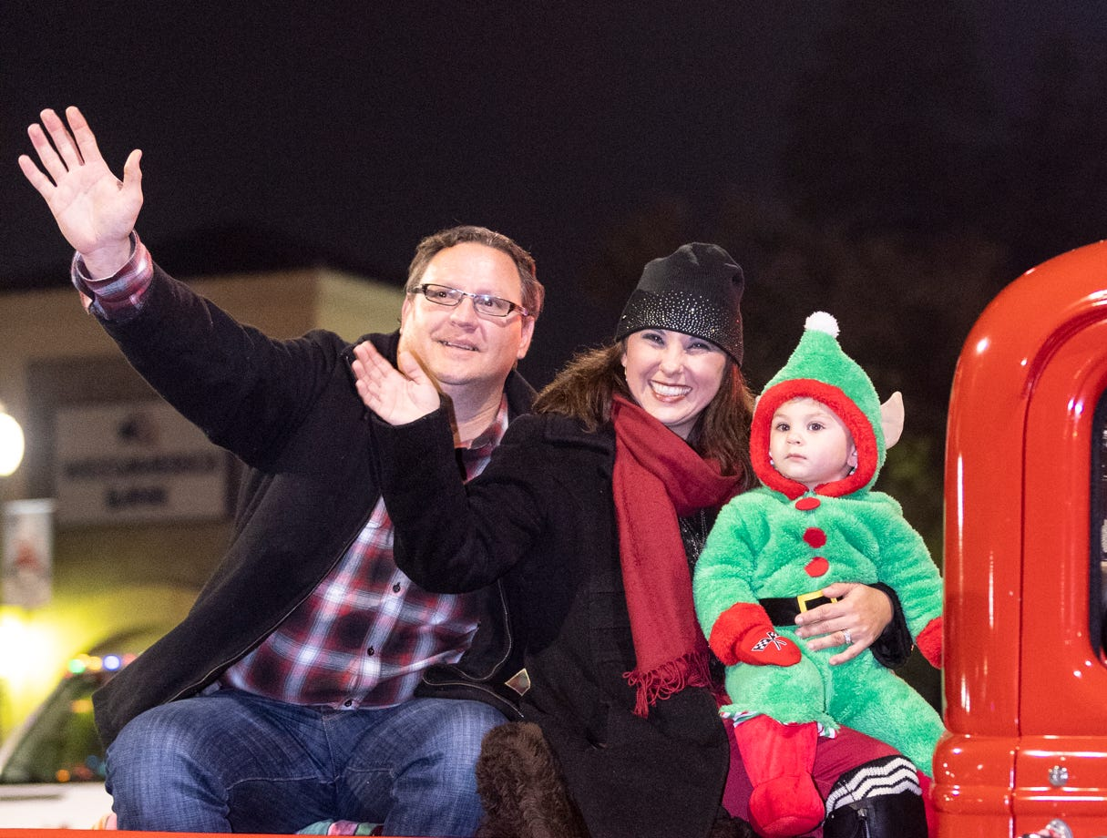 Grand Marshal Kerissa Postma-Chapman, center, rides with her family in Tulare Children's Christmas Parade and Tree Lighting on Thursday, December 6, 2018.