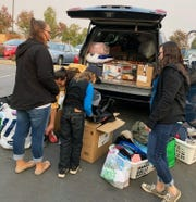 Eliana West's friends and family unload their car during a visit to Chico to donate items to victims of the Camp Fire.
