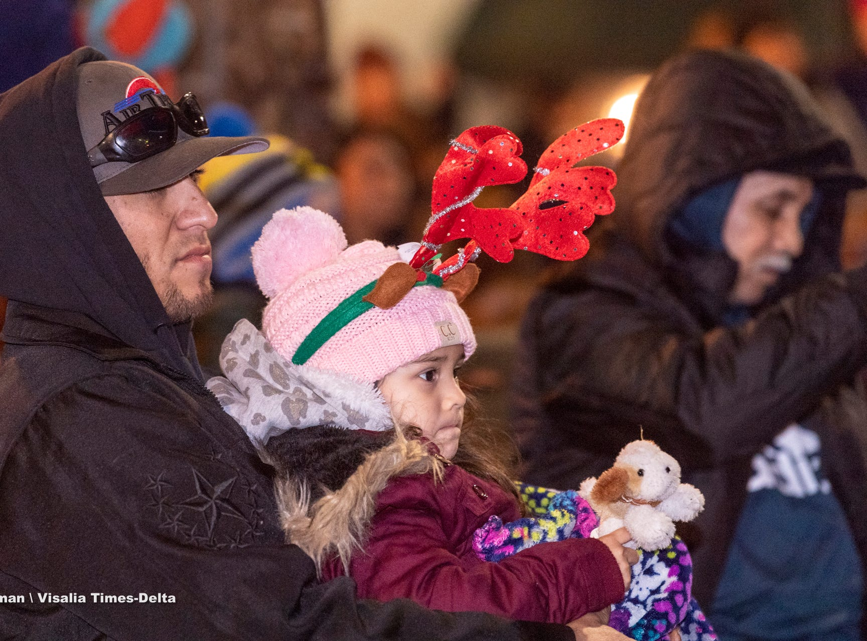 Alberto Luna of Tulare holds his daughter Scarlett Luna, 4, during the Tulare Children's Christmas Parade and Tree Lighting on Thursday, December 6, 2018.