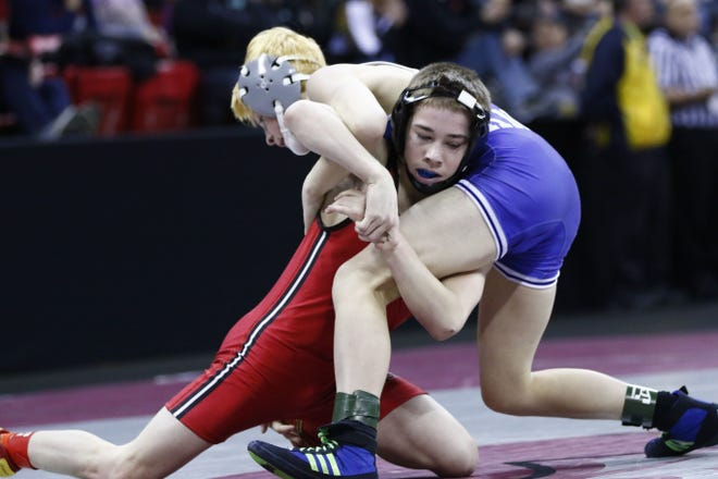 SPASH junior Justin Groshek, left, is ranked No. 1 at 106 pounds in Division 1 in the first Wisconsin Wrestling Online state poll of the season.