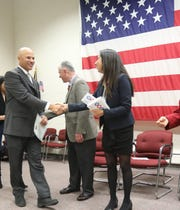 Daniel Polanco, left, of New York was one of 150 Rockland residents who were sworn in as naturalized citizens by Rockland County Clerk Paul Piperato at the Rockland County Fire Training Center in Pomona Dec. 7, 2018.
