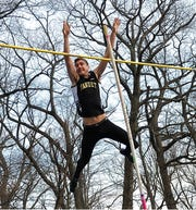 Nanuet's Chris Filatov vaults an outdoor-best 13-6 to win the pole vault at the Pearl River Relays.