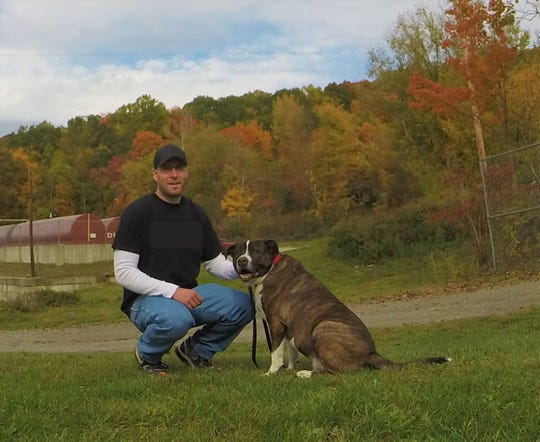 Steve Reid and his dog, Fonzi. Reid is a Somers dog trainer.