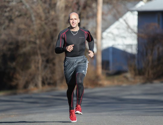Rockland doctor and former Tappan Zee High School cross-country runner, Tro Kalayjian, photographed running in his Tappan neighbothood on Friday, December 7, 2018.