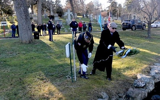 New York State Senator-Elect Peter Harckham throws a wreath into a lake at Kensico Cemetery in Valhalla during a ceremony Dec. 7, 2018 honoring the fifteen members of the U.S. Navy who received the Congressional Medal of Honor for their actions during the attack on Pearl Harbor. The ceremony was held by the American Legion Post 112 in Hawthorne and the New York Medal of Honor Committee . About thirty people attended the ceremony, which took place on the 77th anniversary of the Japanese attack on Pearl Harbor during World War II.