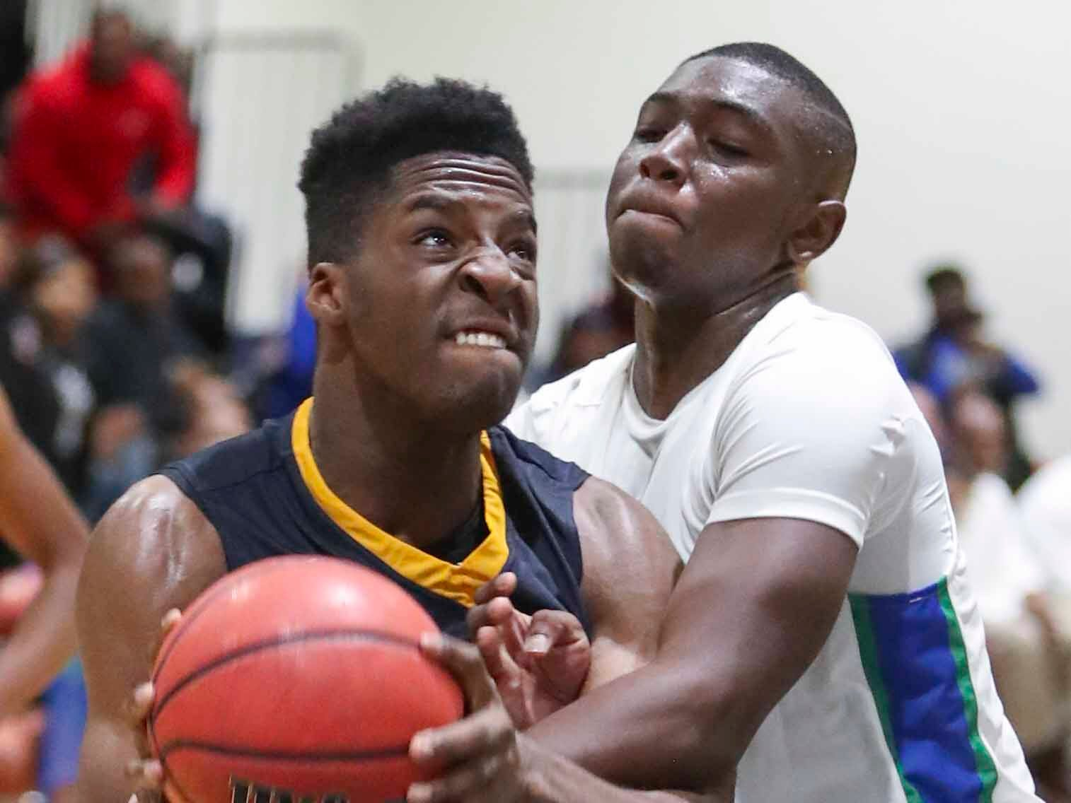 Sanford's Nnanna Njoku (left) tangles with St. Georges' Michael McCants late in Sanford's 61-56 overtime win at St. Georges Thursday.