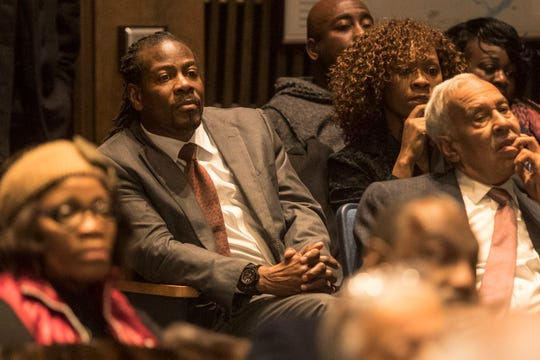 Outgoing Wilmington City Councilman Nnamdi Chukwuocha's twin brother, Albert Mills, listens to discussion of his potential selection to the Wilmington City Council Thursday night in the council chambers.