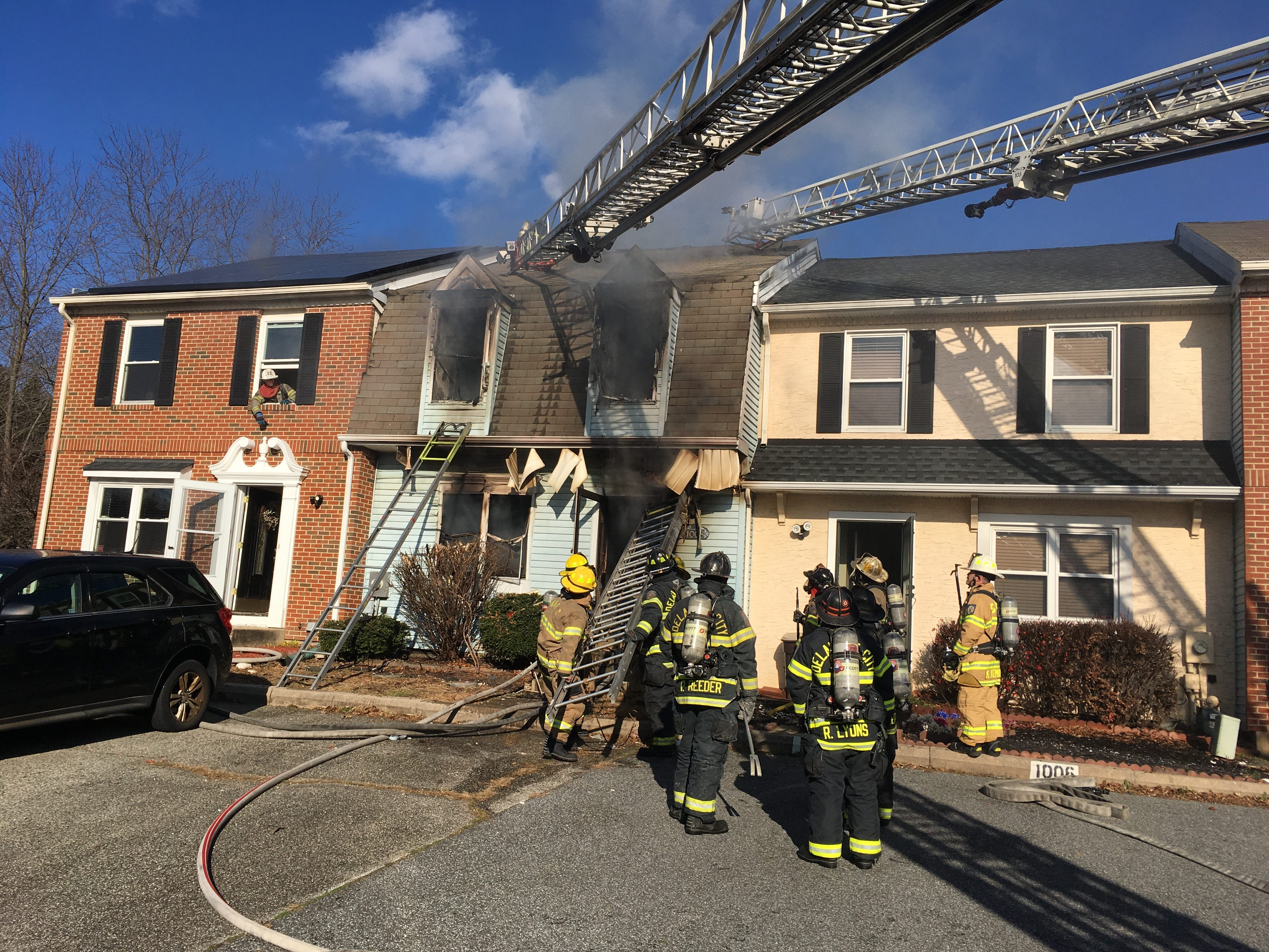 Firefighters at the scene of a fatal fire near New Castle.